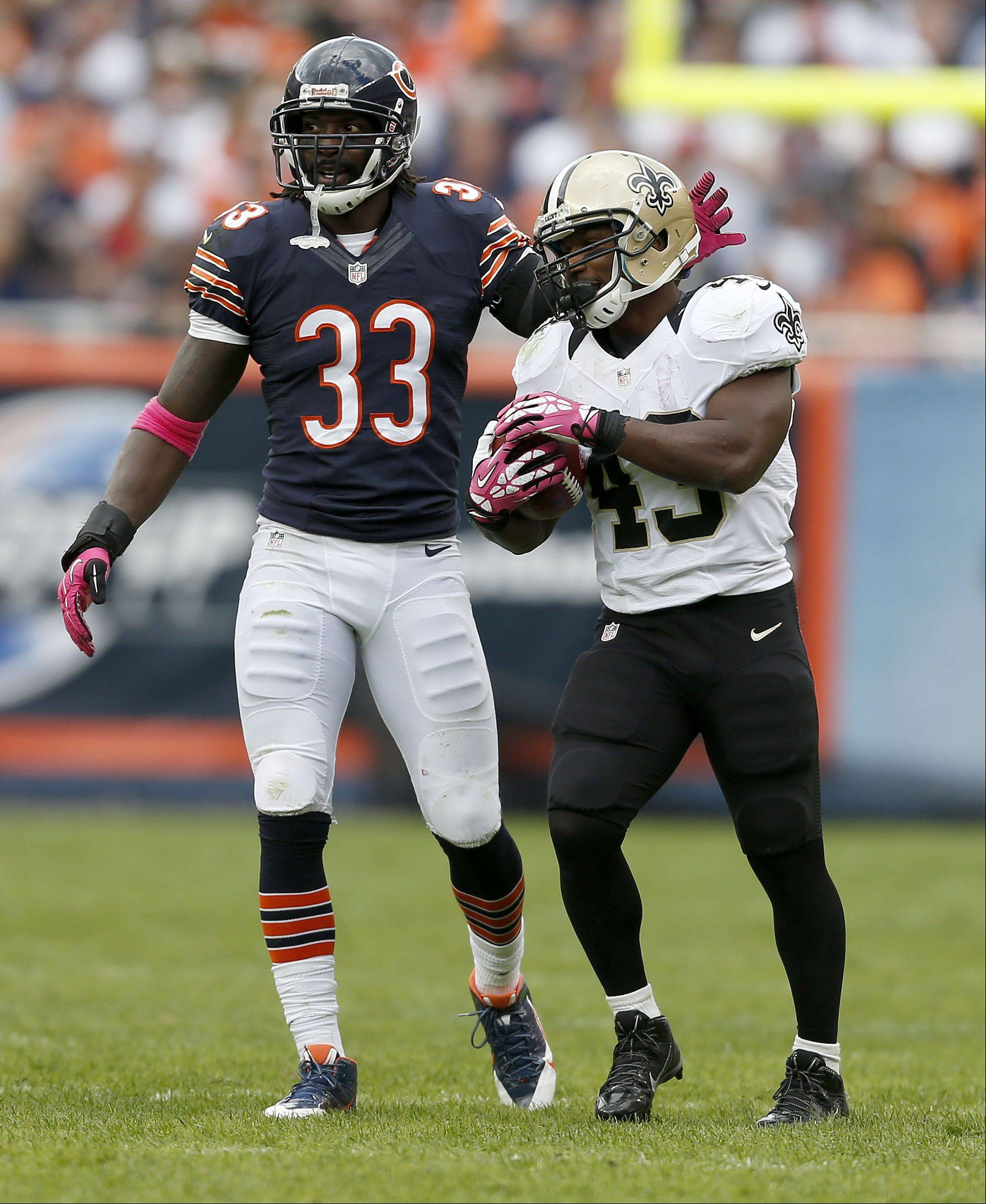 Chicago Bears cornerback Charles Tillman pats New Orleans Saints running back Darren Sproles on the head during the Bears 26-18 loss Sunday at Soldier Field in Chicago.