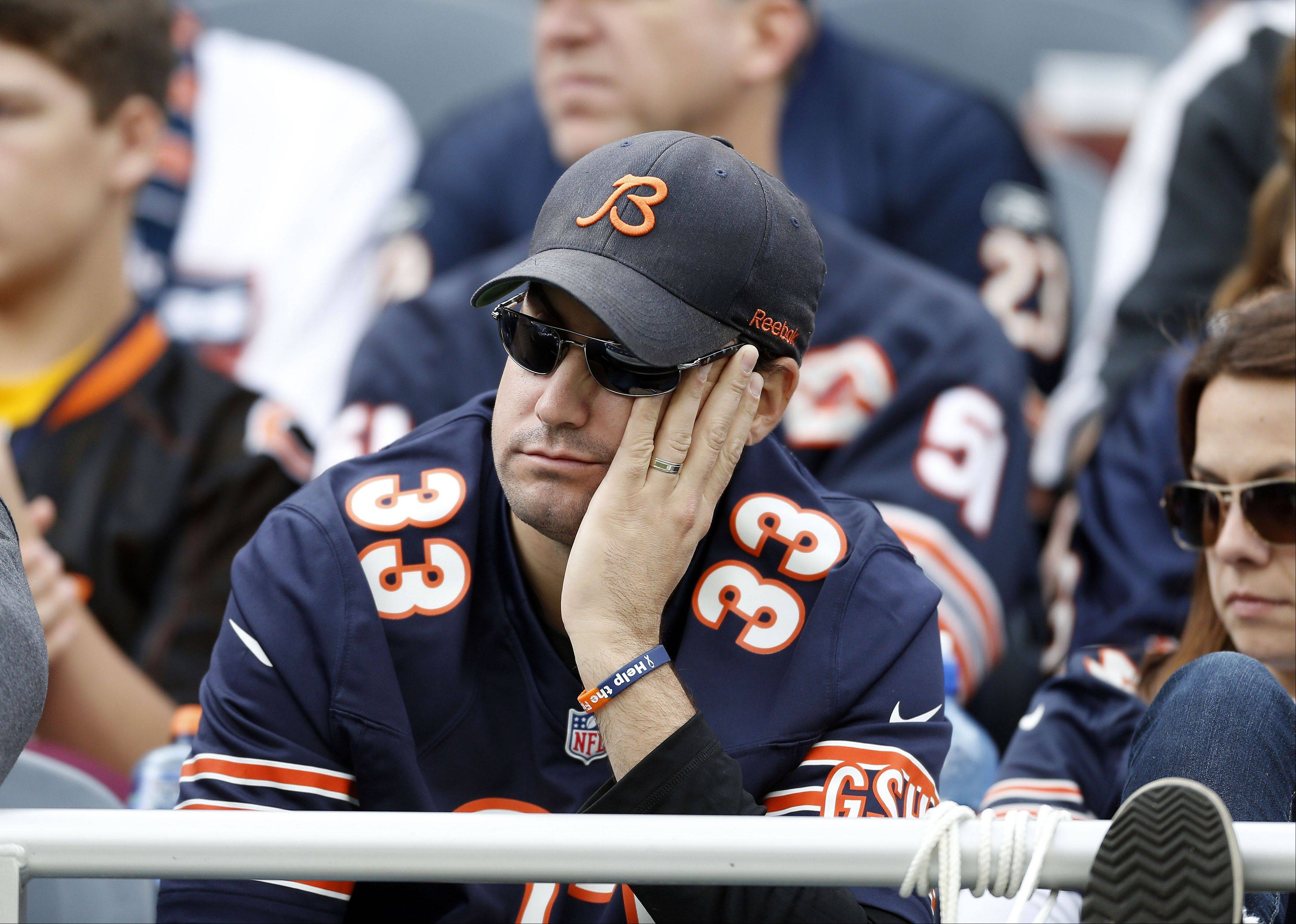 Bears fans look dejected during the Bears 26-18 loss to the New Orleans Saints Sunday at Soldier Field in Chicago.
