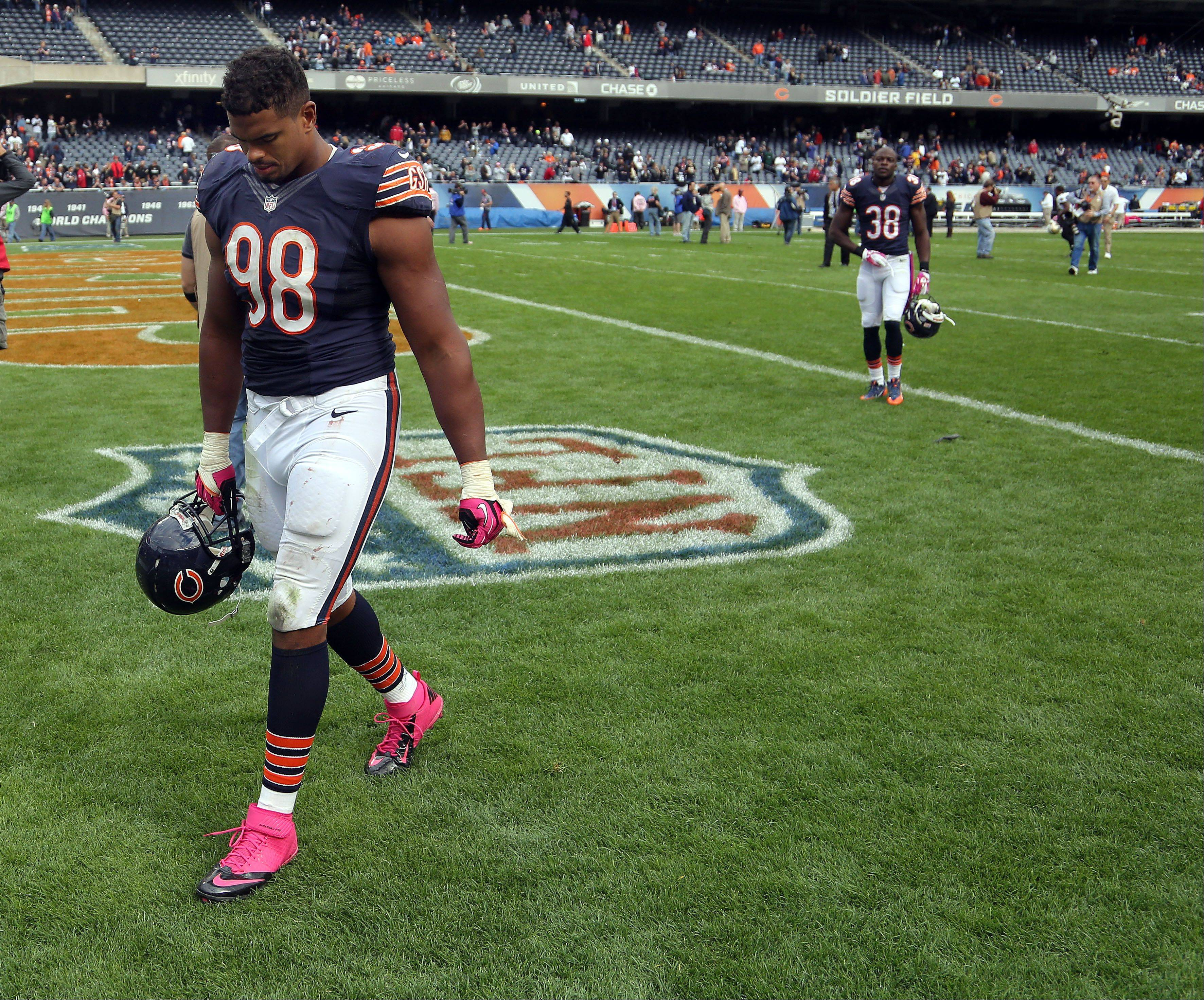 Chicago Bears defensive end Corey Wootton walks off the field after the Bears 26-18 loss to the New Orleans Saints Sunday.