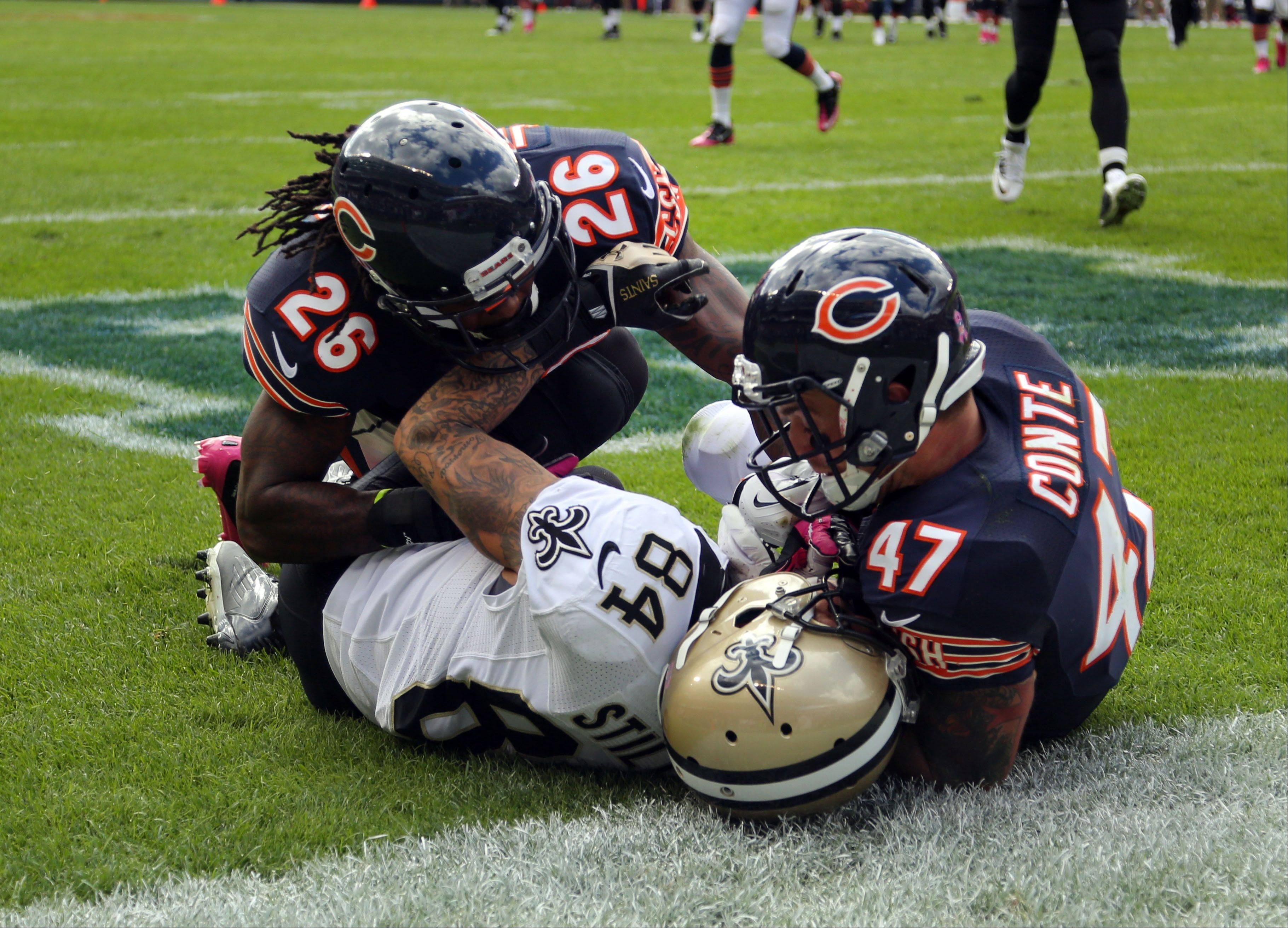 Chicago Bears cornerback Cornerback Tim Jennings and Chicago Bears free safety Chris Conte break up a pass play to New Orleans Saints wide receiver Kenny.