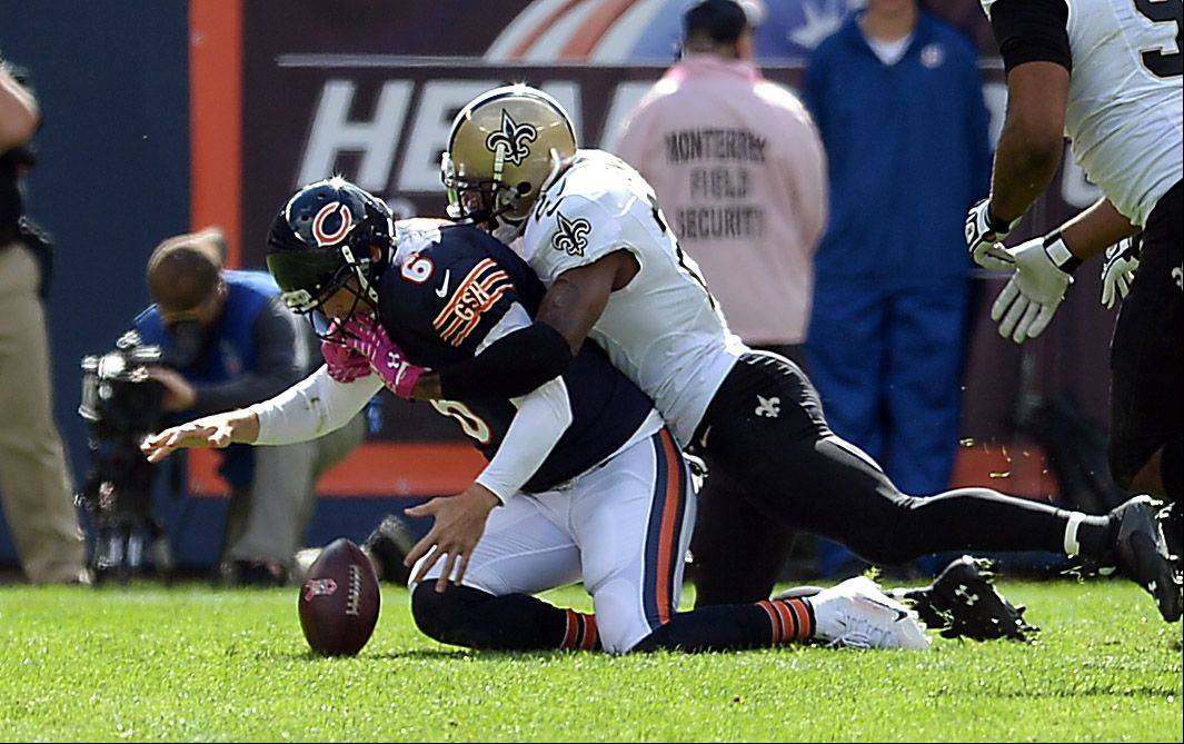 Bears quarterback Jay Cutler is sacked in the first quarter by Saints Malcolm Jenkins at Soldier Field on Sunday.