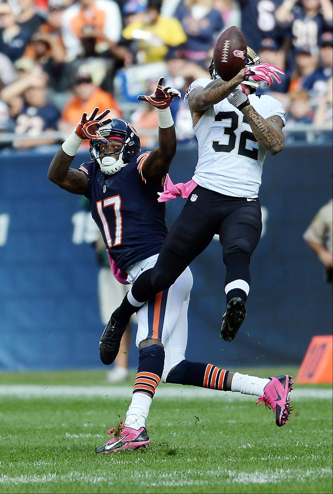 Bears receiver Alshon Jeffery has the ball knocked away by Saints Kenny Vaccaro in the first half at Soldier Field on Sunday.
