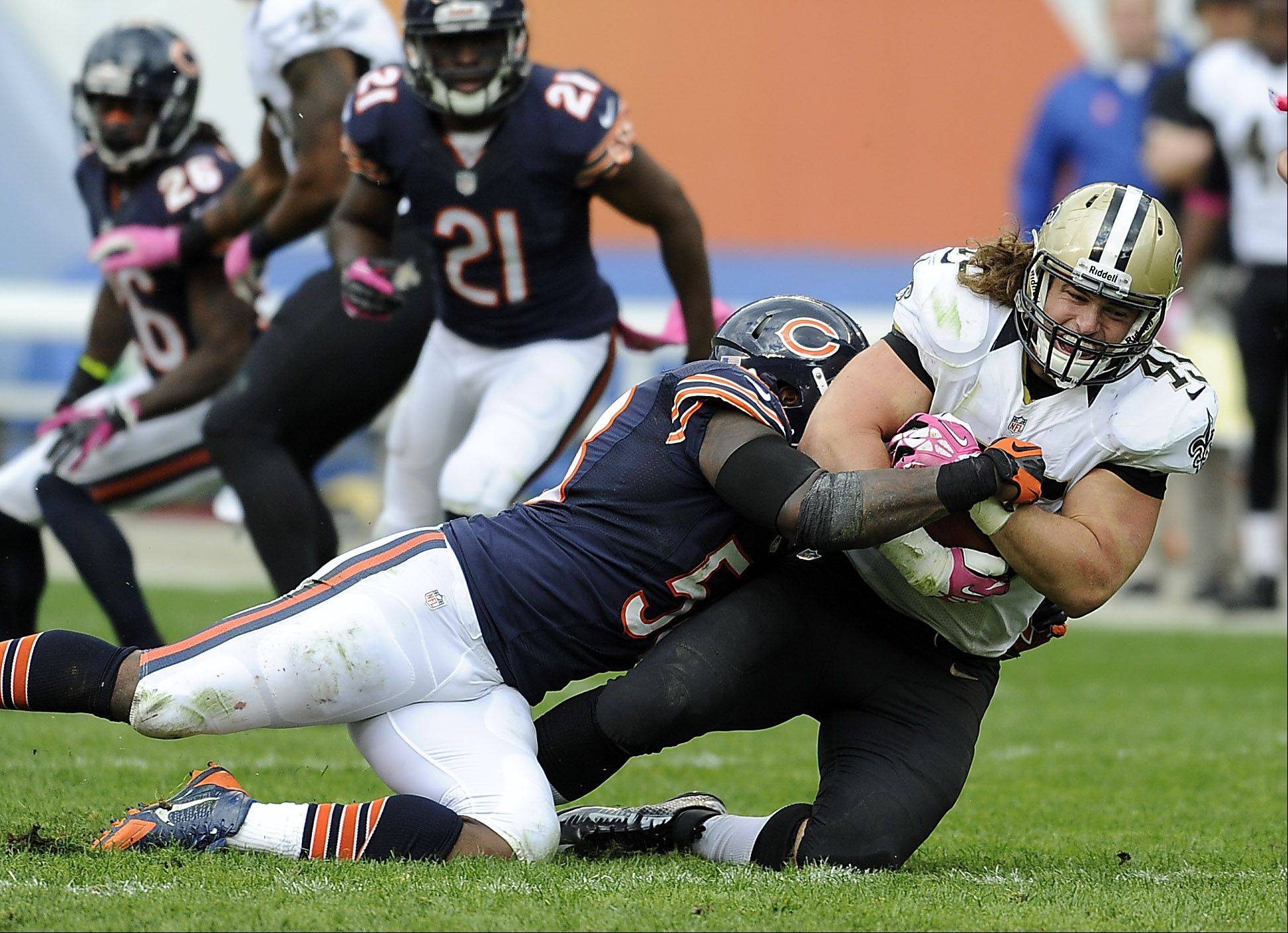 Bears D.J. Williams puts the hit on Jed Collins on this Saints drive in the 4th quarter in the Bears loss at Soldier Field on Sunday.