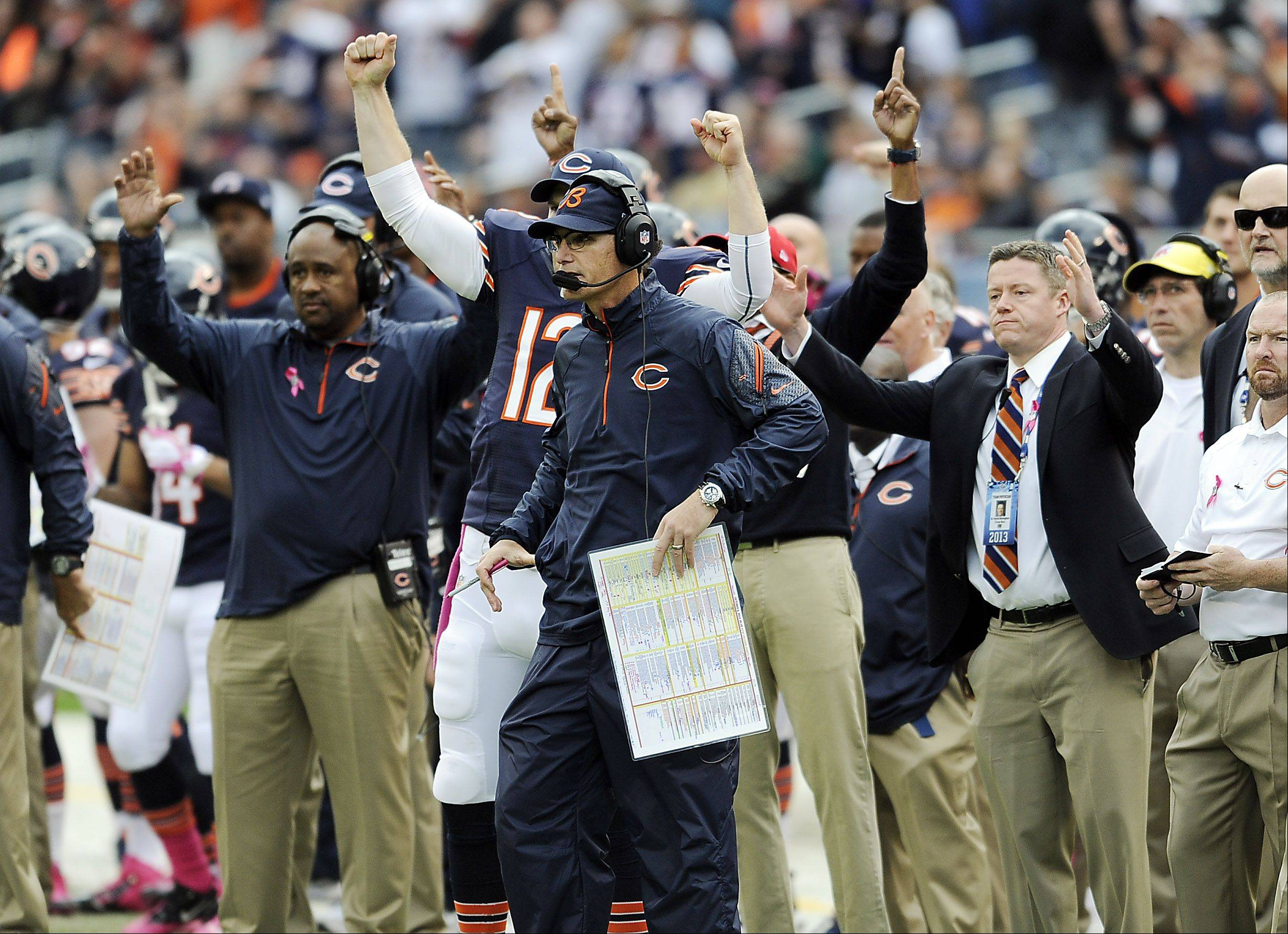 The Bears sideline and coach Marc Trestman celebrate their two point conversion late in the fourth quarter against the Saints at Soldier Field on Sunday.
