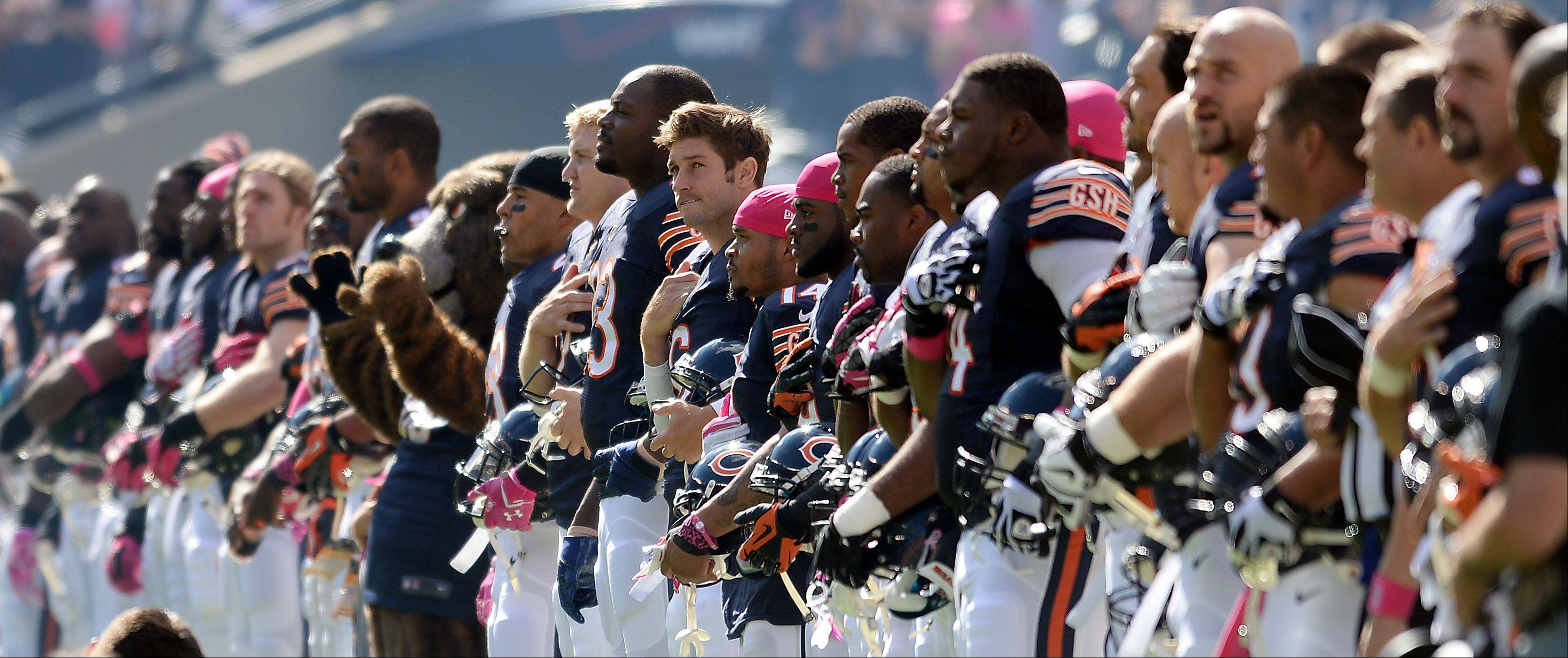 Bears quarterback Jay Cutler stands with the rest of his teammates before the game at Soldier Field as they prepare to play the Saints.