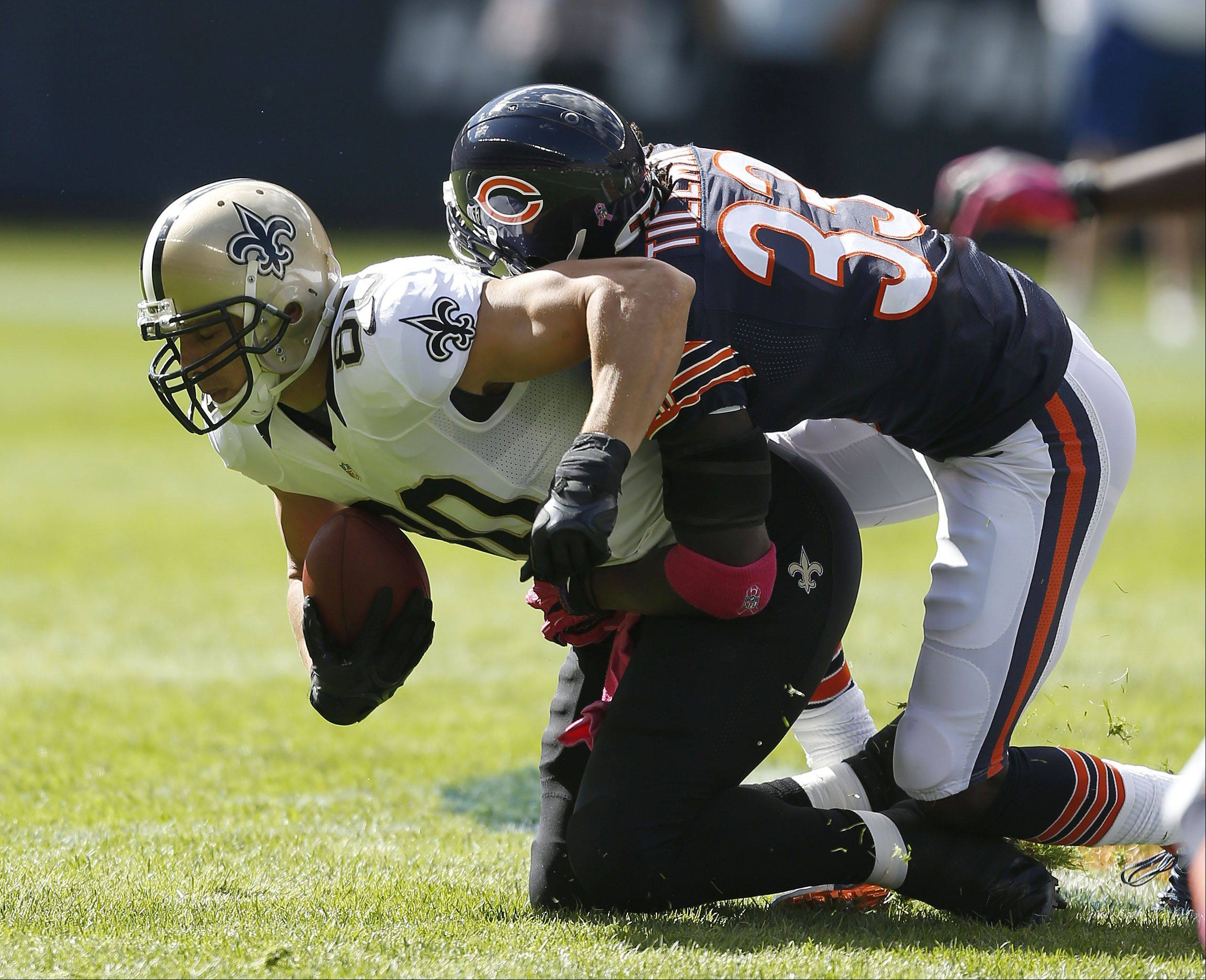 New Orleans Saints tight end Jimmy Graham is tackled by Chicago Bears cornerback Charles Tillman.