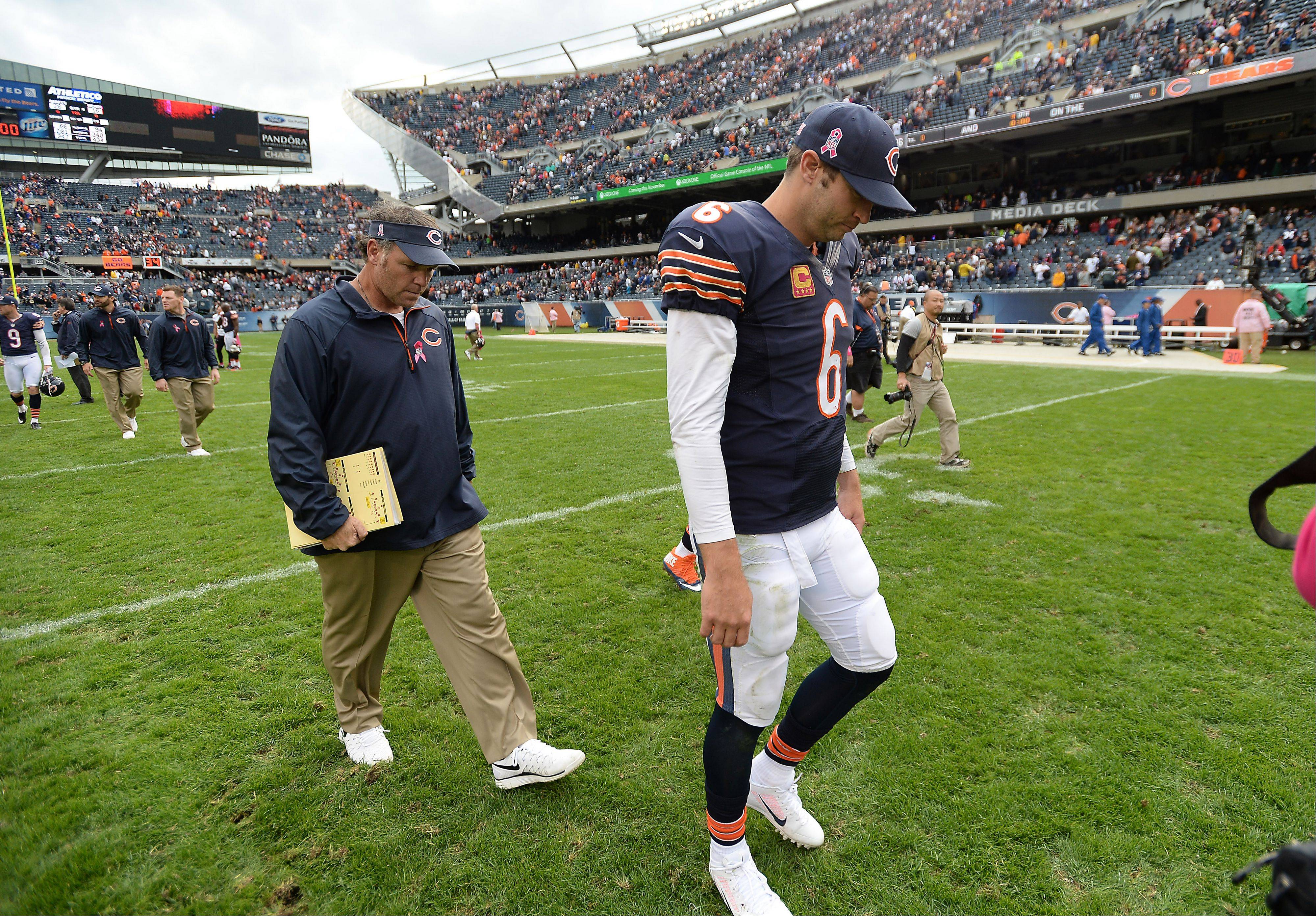 Bears quarterback Jay Cutler walks off the field at the end of the end as the Bears loss 26-18 at Soldier Field.