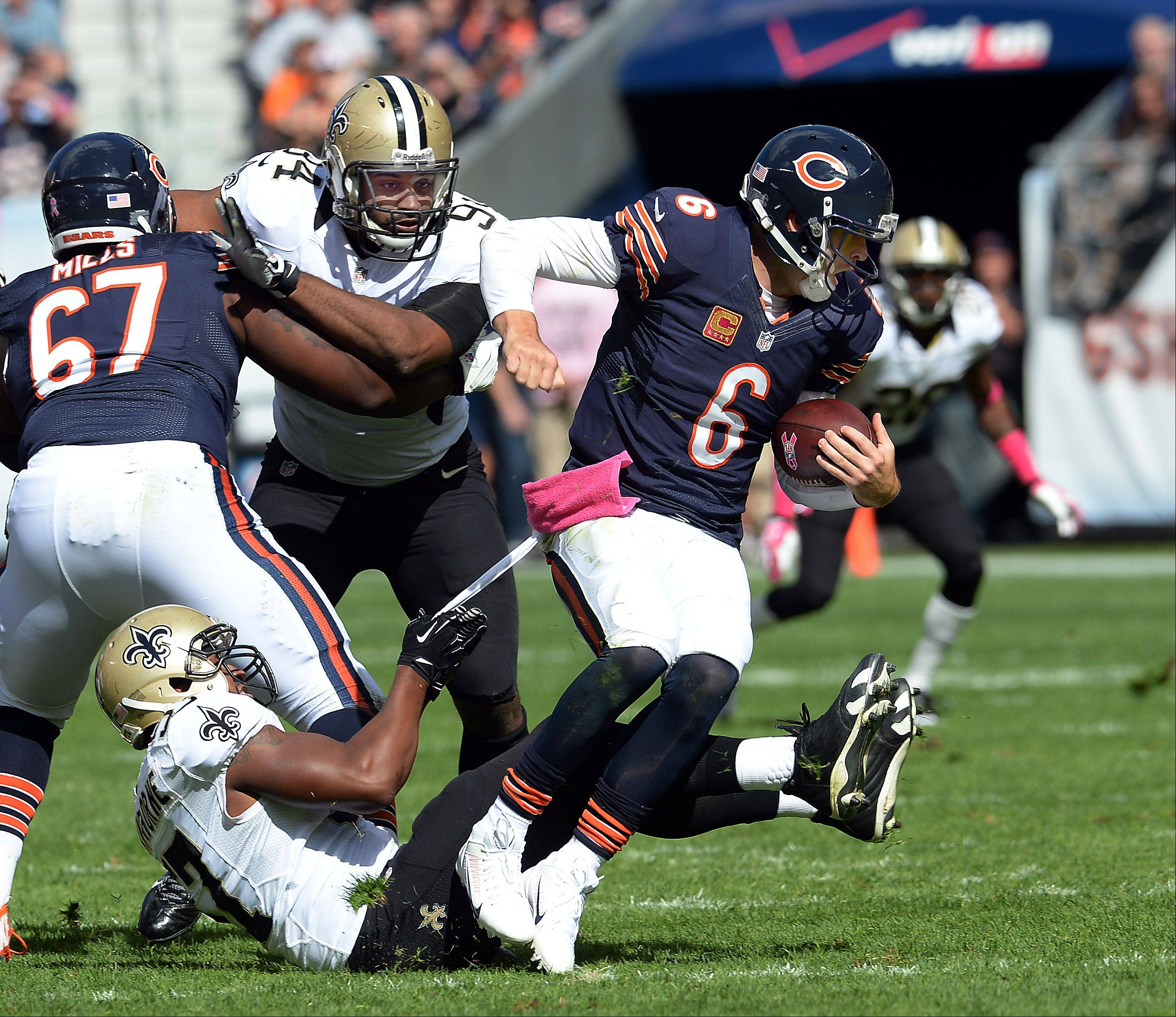 Bears quarterback Jay Cutler is sacked in the first half by Saints David Hawthorne.
