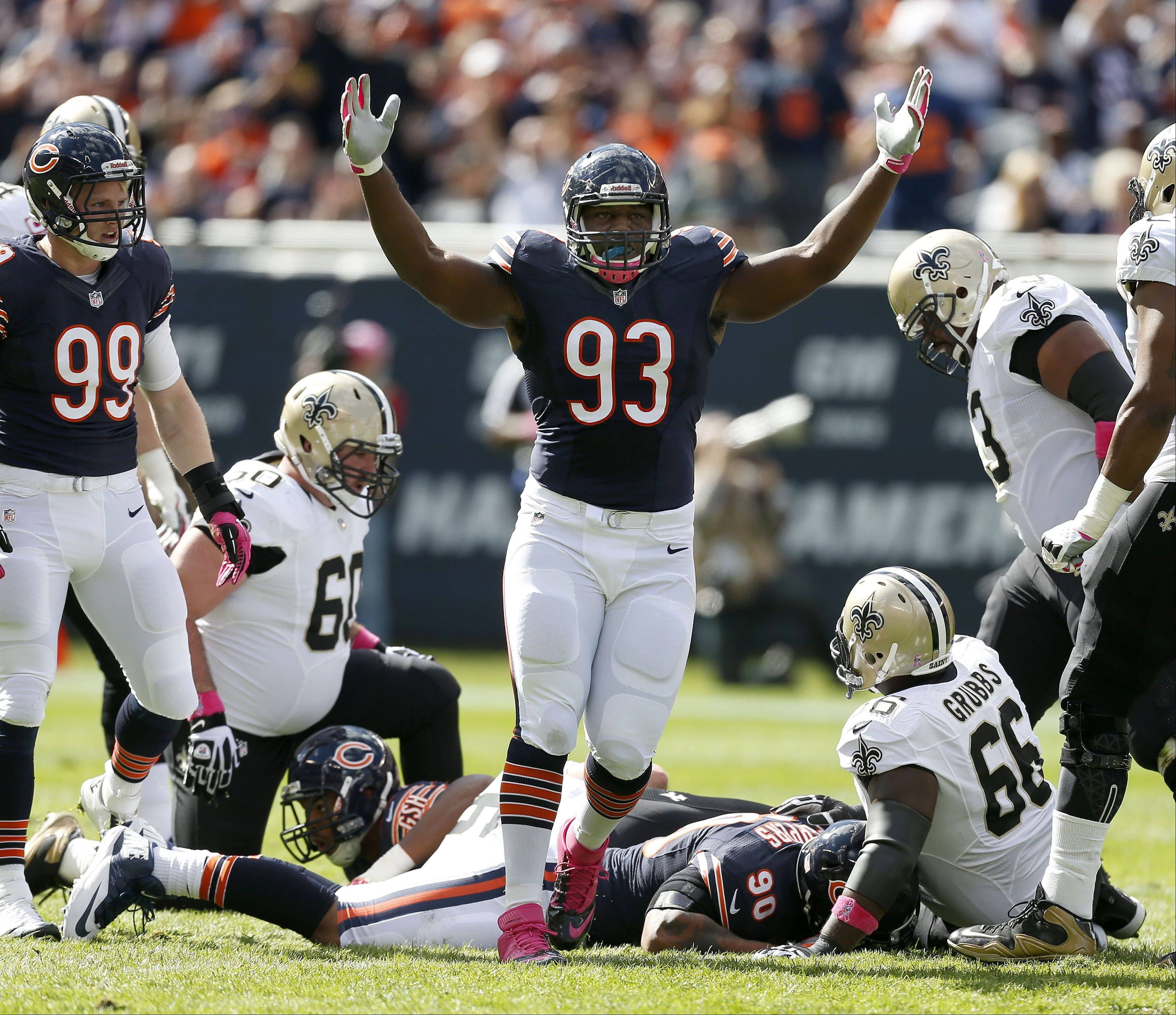 Chicago Bears defensive tackle Nate Collins celebrates after a sack.
