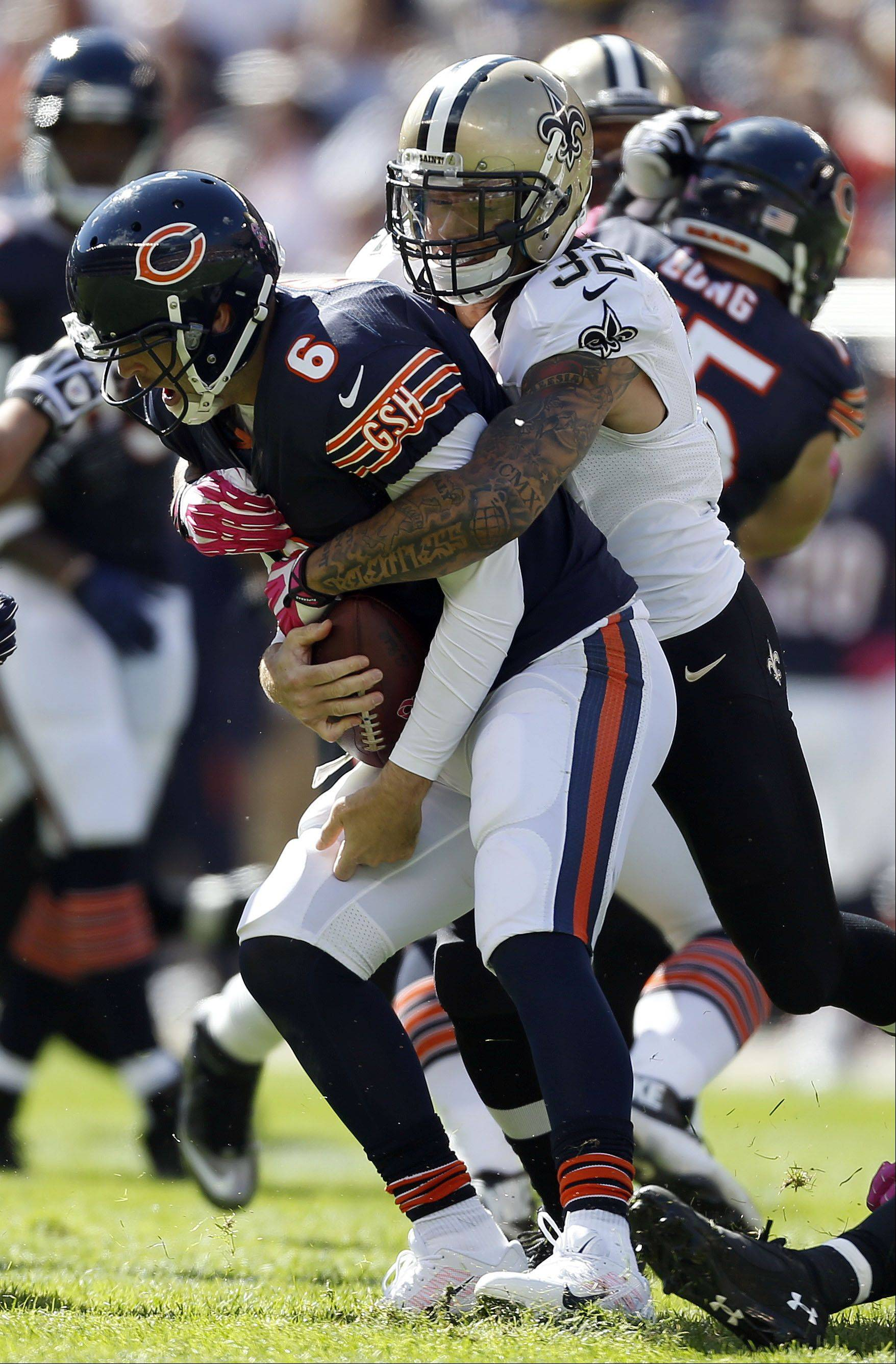 Chicago Bears quarterback Jay Cutler is sacked by New Orleans Saints strong safety Kenny Vaccaro.
