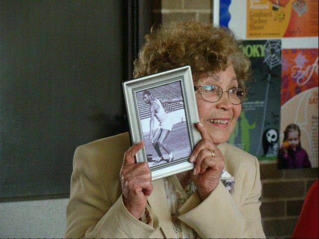 Darwin Walton holds a picture of her husband, Claude, during ceremonies in Lombard where Claude was named Senior of the Year for 2013. Claude, 100, was not feeling up to attending the ceremony.