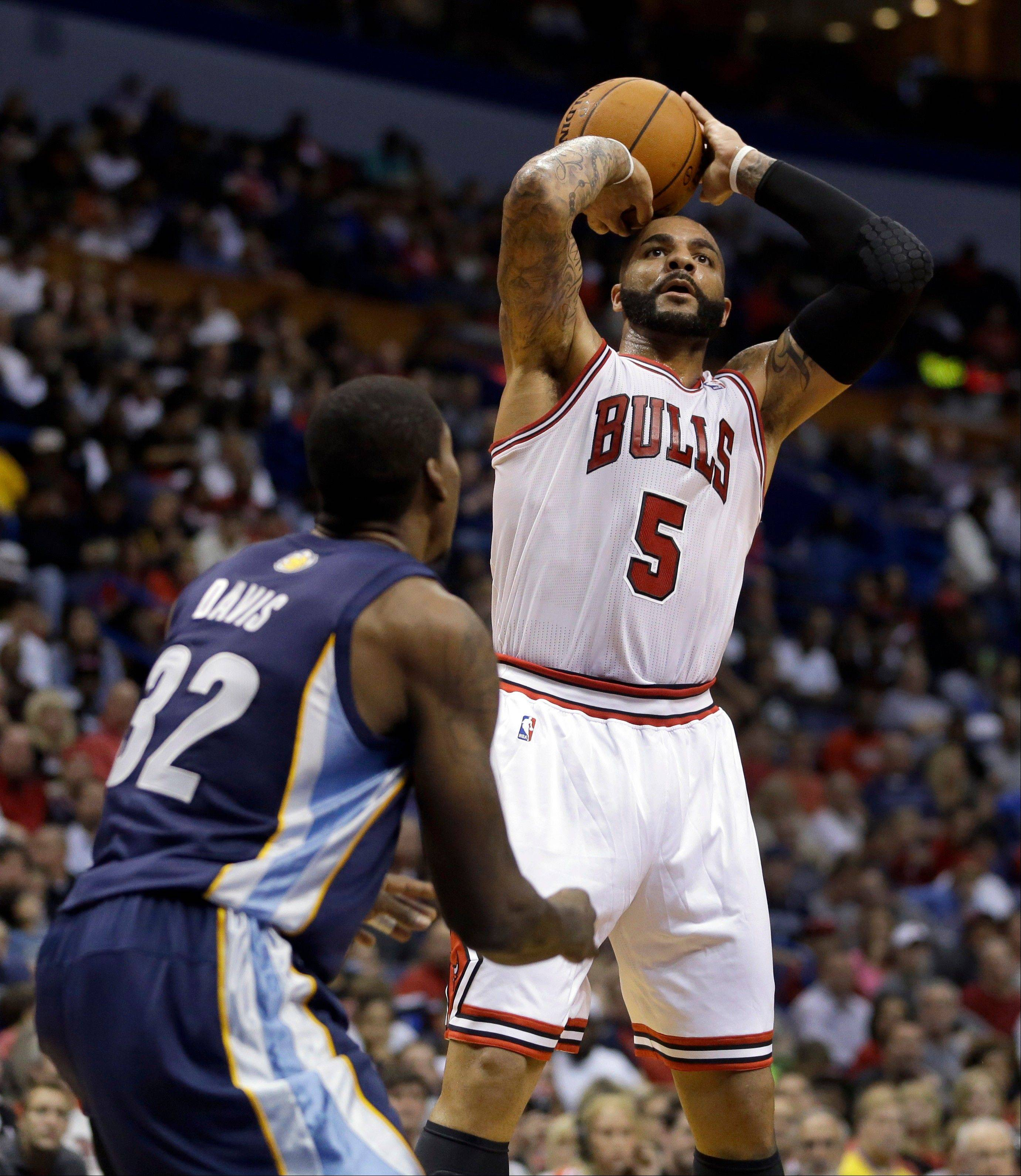 The Bulls' Carlos Boozer shoots over Memphis' Ed Davis during the second half of an NBA preseason basketball game Monday in St. Louis.