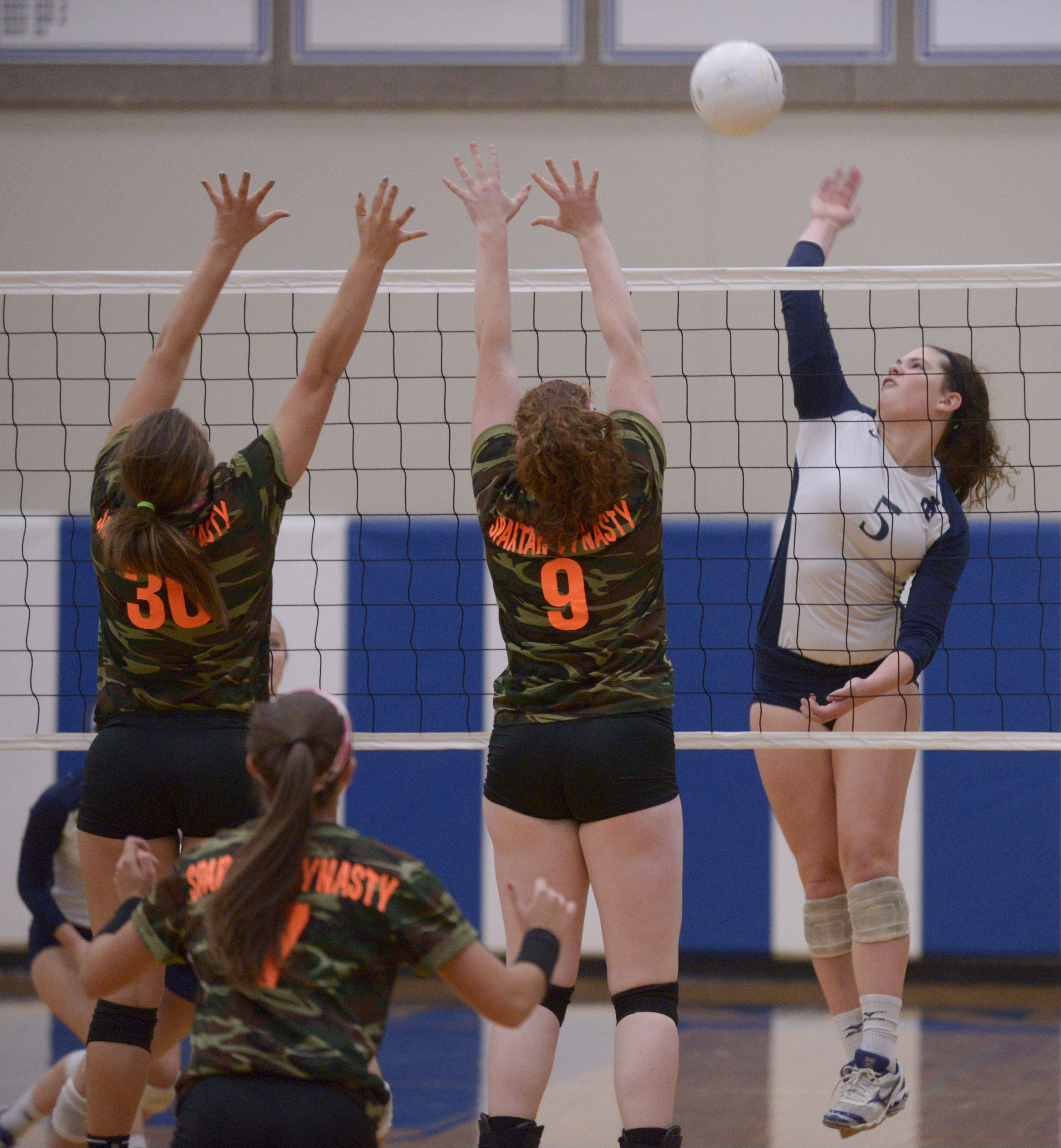 Kristin Acciavatti and Sarah Muisenga of St. Francis attempt to block a shot by Rory Manion of IC Catholic Prep during girls volleyball, Monday.