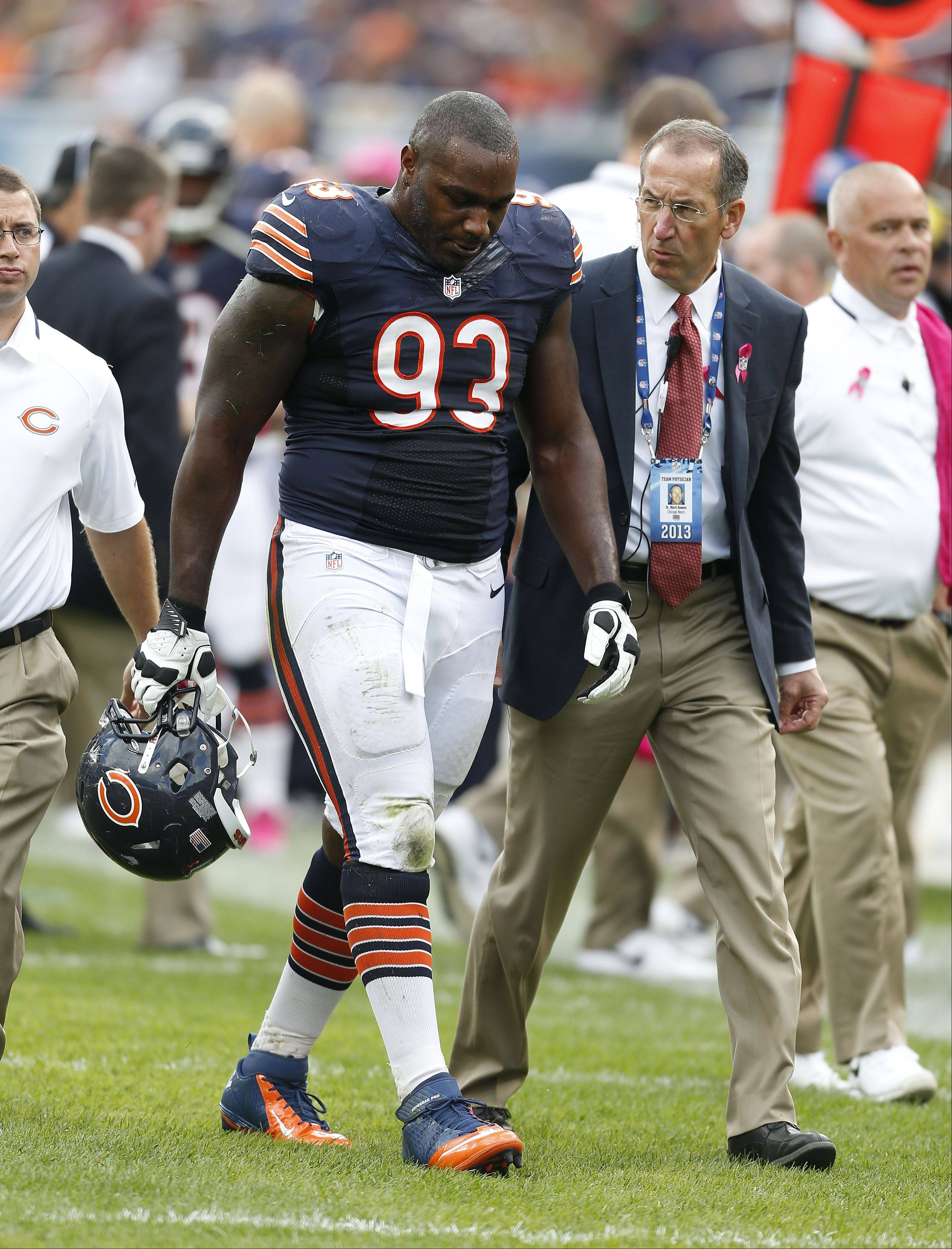 Bears defensive tackle Nate Collins leaves Sunday's game after a knee injury ended his season.