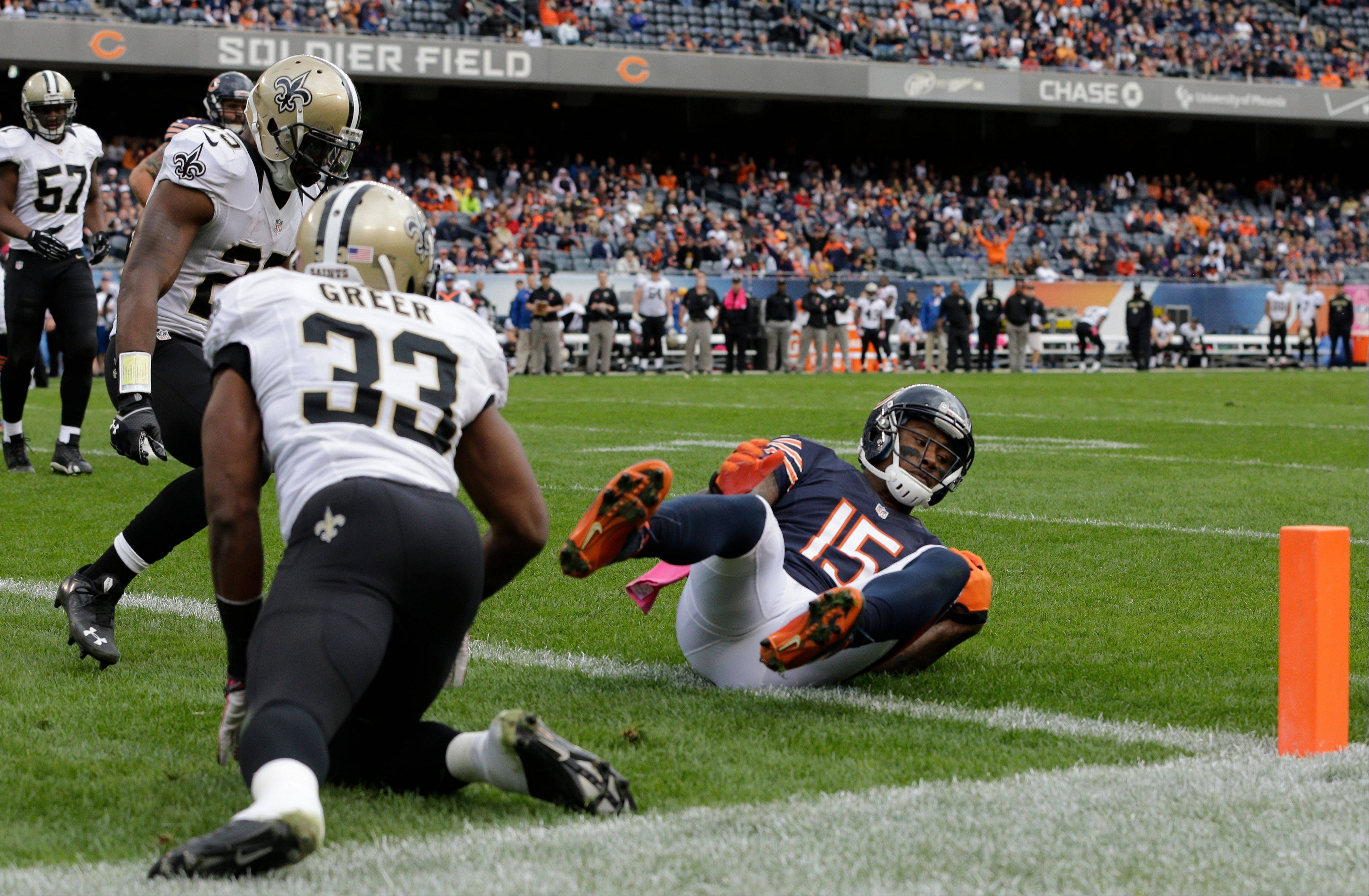 Bears wide receiver Brandon Marshall makes a touchdown reception during the second half of Sunday�s loss to the Saints.