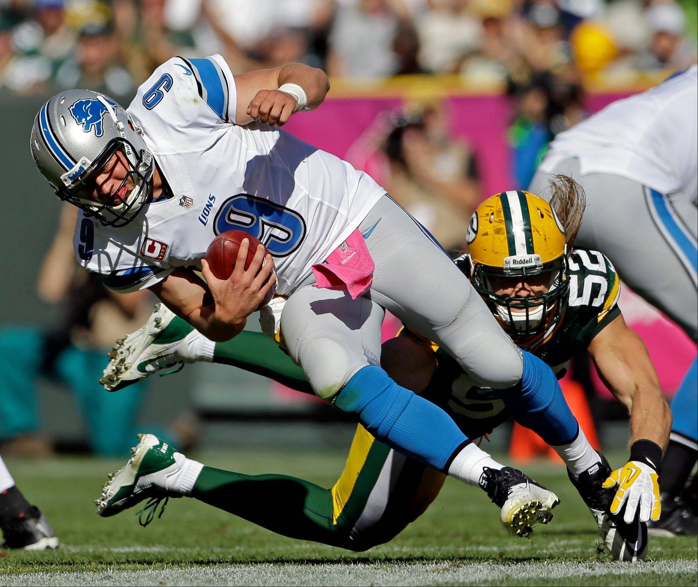The Packers� Clay Matthews sacks Detroit quarterback Matthew Stafford during the second half of Sunday�s game in Green Bay. Matthews injured his thumb on the play.