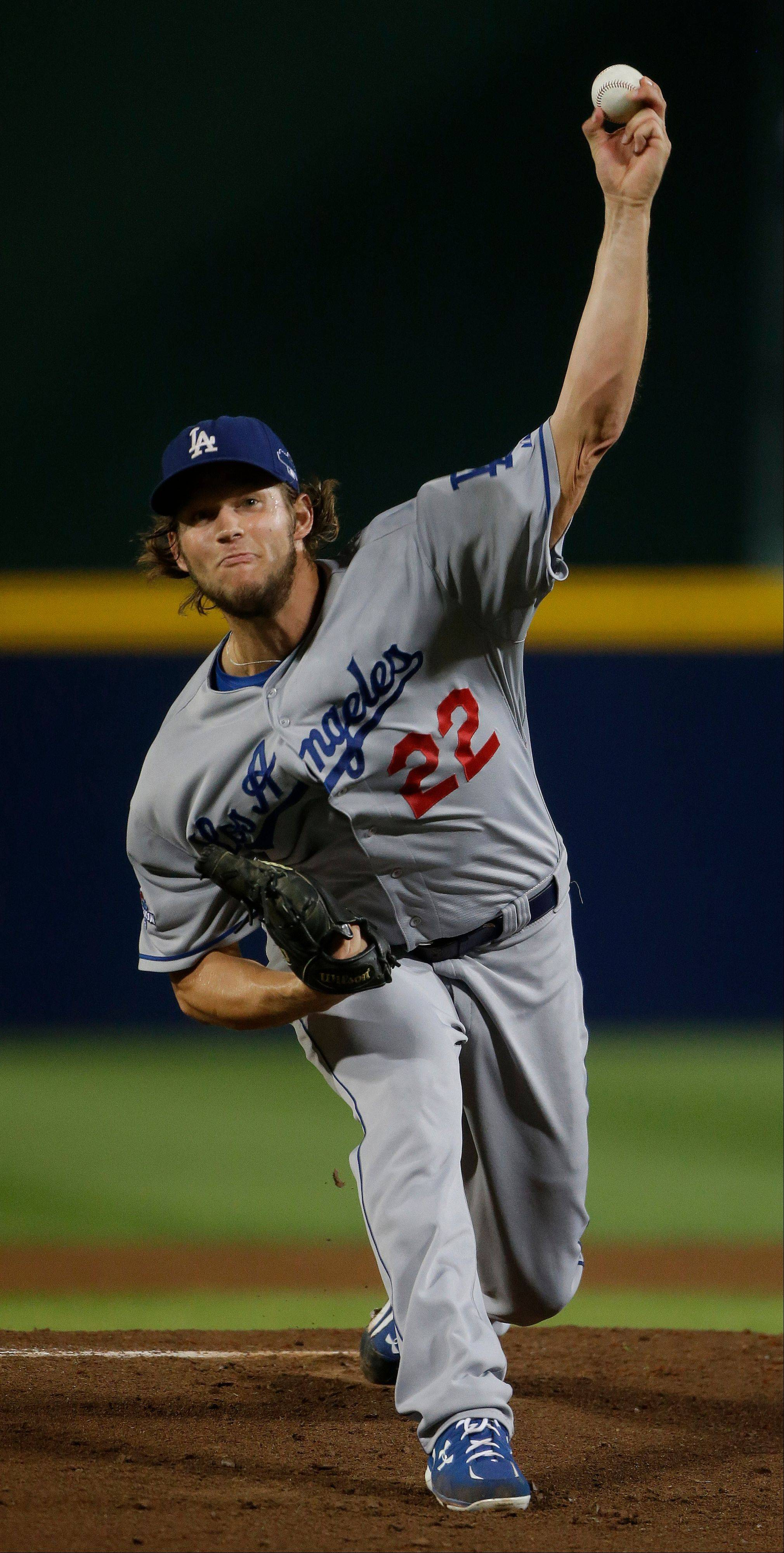 Dodgers starting pitcher Clayton Kershaw works against Braves in the first inning of Game 1 of the National League Divisional Series Thursday in Atlanta.