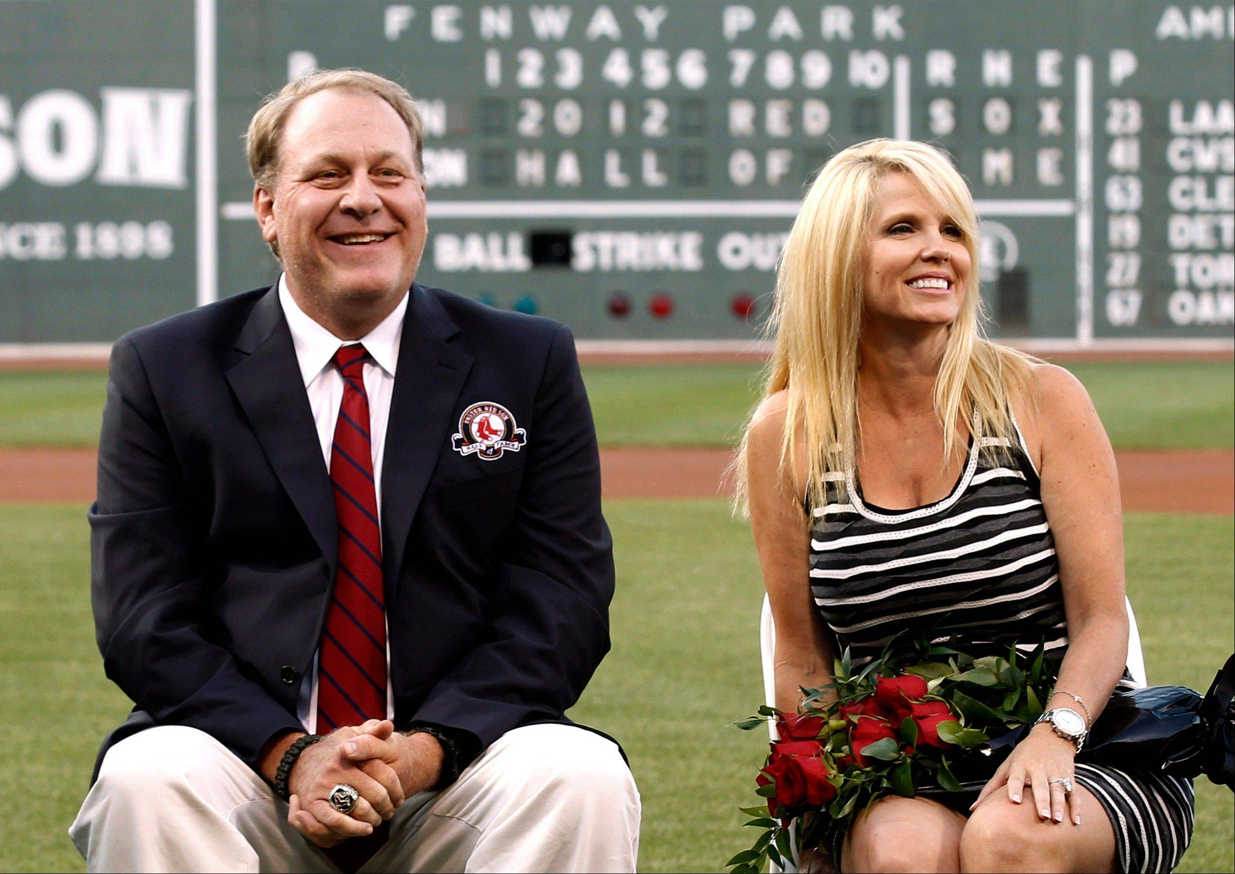 Former Boston Red Sox pitcher Curt Schilling, sitting with his wife, Shonda, was introduced as a new member of the Red Sox Hall of Fame last fall. The Schilling home, which he bought from former Patriots quarterback Drew Bledsoe for $4.5 million, is for sale for $3 million. It has a heated eight-car garage, a batting/pitching cage, putting green and wine room.