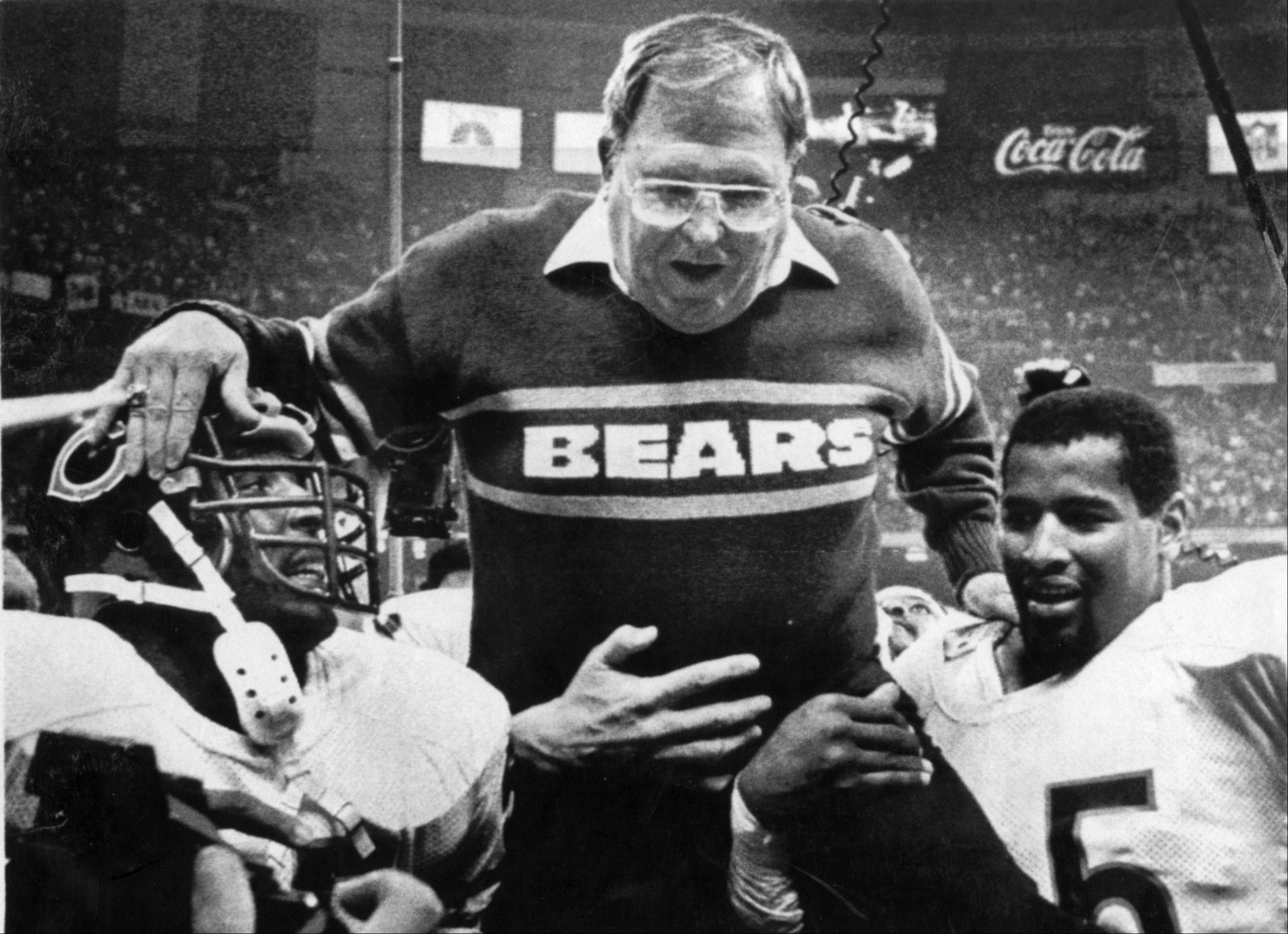Chicago Bears defensive coordinator Buddy Ryan is hoisted on the shoulders of Otis Wilson, left, and Richard Dent, right, after the Bears' lopsided 46-10 victory over the New England Patriots in Super Bowl XX in 1986.