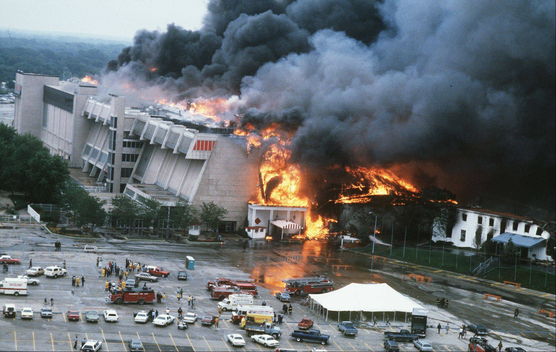 Flames engulf Arlington Park racetrack on July 31, 1985. Less than a month later the Arlington Million was held there, with spectators in temporary bleachers. The newly rebuilt grandstand fully opened in 1989.