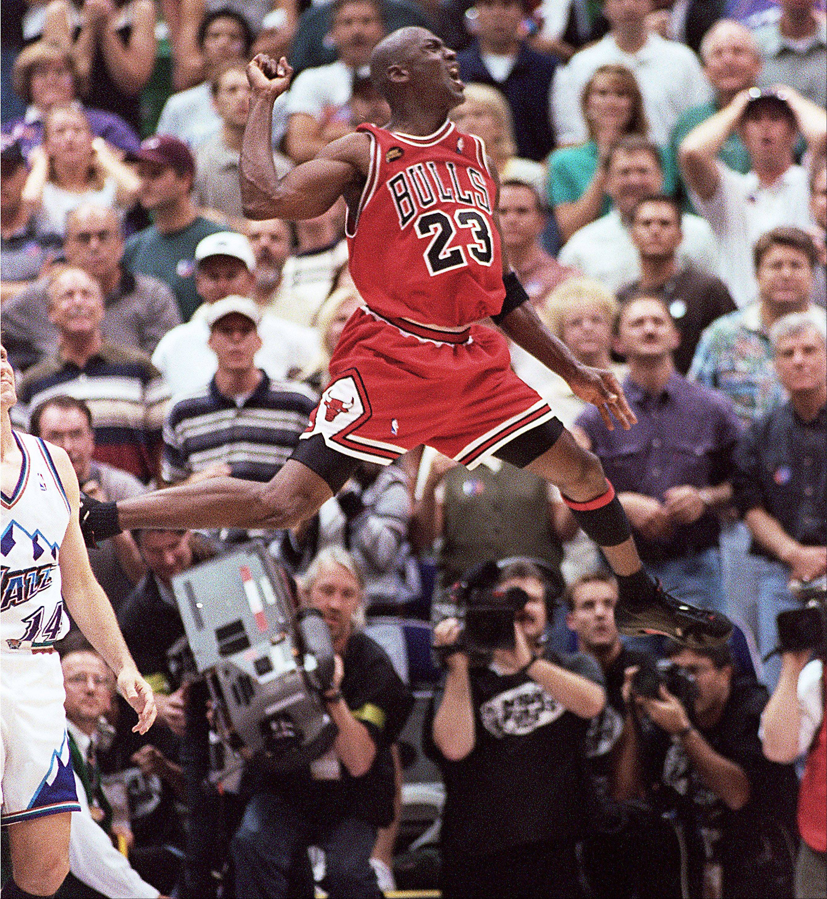 Michael Jordan jumps for joy as the Chicago Bulls win their second three-peat during the '90s against the Utah Jazz in the 1998 NBA Finals.