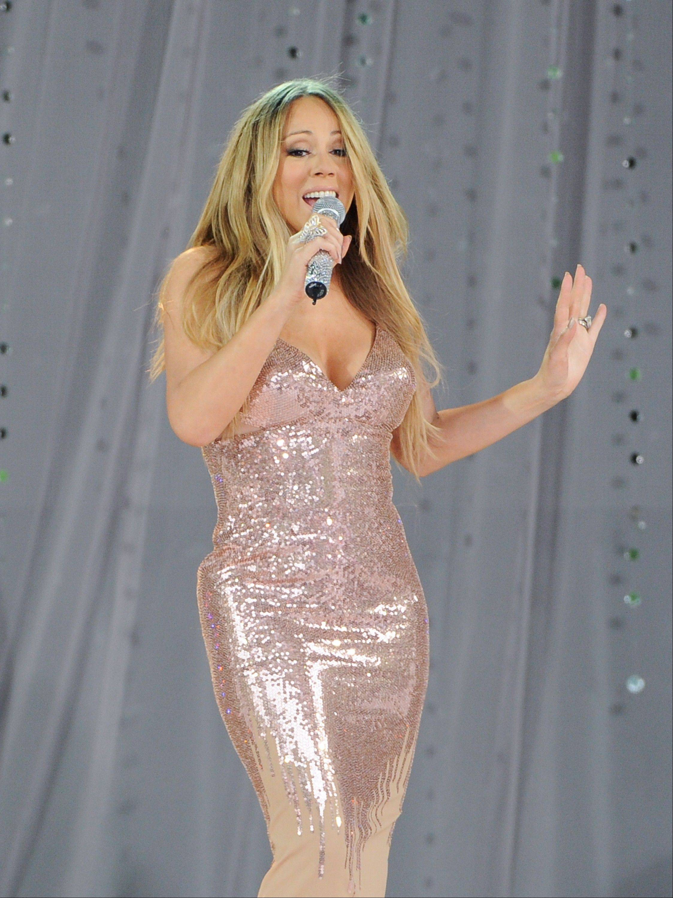 "In this May 24, 2013 file photo, singer Mariah Carey performs on ABC's ""Good Morning America"" in Central Park in New York. Carey is teaming up again with producer Jermaine Dupri. Dupri and Carey have collaborated on hits like ""Always Be My Baby,"" ""Don't Forget About Us"" and ""We Belong Together."""