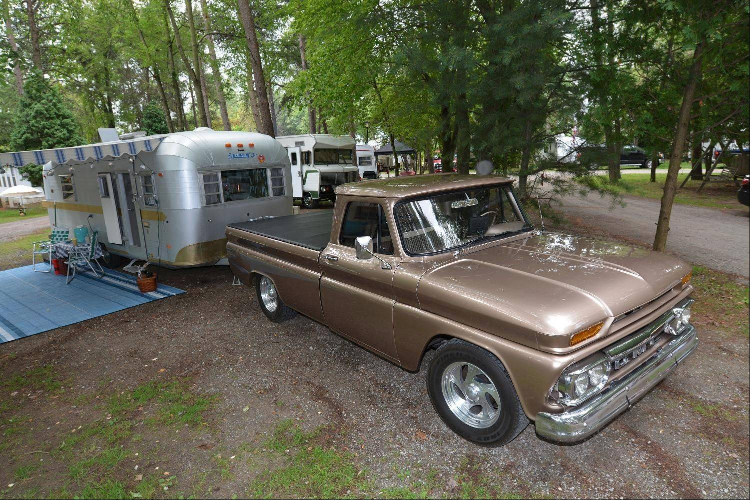 "Mike and Cheryl O'Conner, of Portland, Mich., restored their 1969 Streamline trailer and 1966 GMC pickup. Mike said: ""The rally is like a car show you get to sleep at!"""