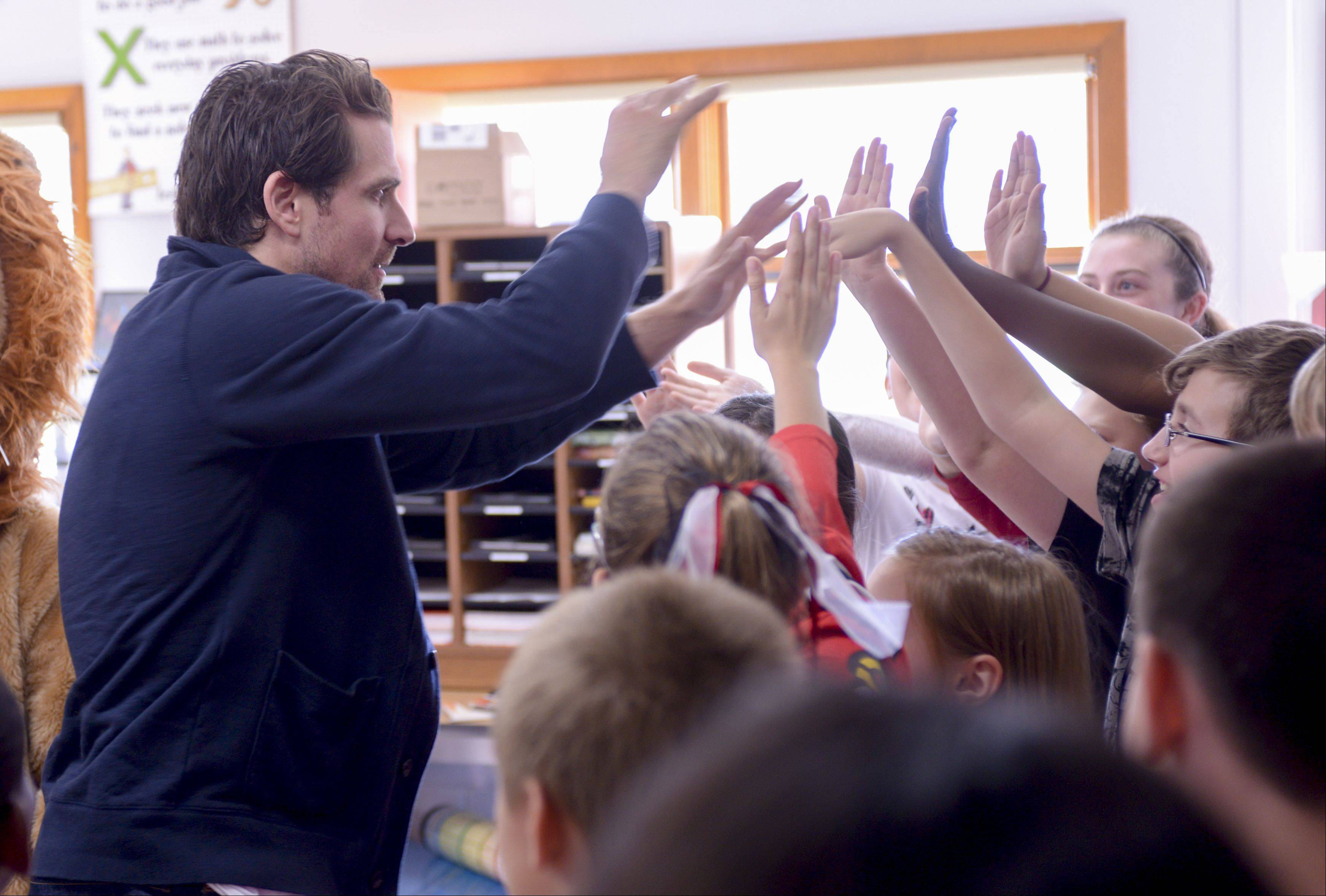 Chicago Blackhawks left wing Patrick Sharp visited every classroom at Lisle Junior High School Monday to reward students for their generosity during Goodwill's Pass It On Donation Challenge.