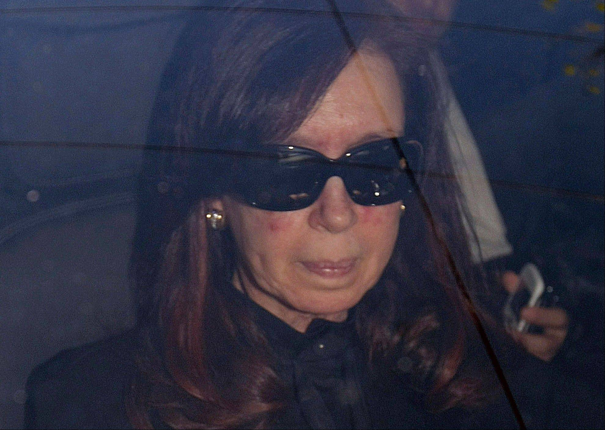 "Argentina's President Cristina Fernandez arrives to a local hospital, in Buenos Aires, Argentina, Monday, Oct. 7, 2013. Argentine president is back in the hospital, presumably for more treatment of the head injury that prompted doctors to order a month's rest. Her car entered the Fundacion Favaloro hospital on Monday, as Cabinet members gathered without her in the government palace for a speech by Vice President Amado Boudou, who wished her strength and said they would carry on, ""giving her the rest she deserves."""