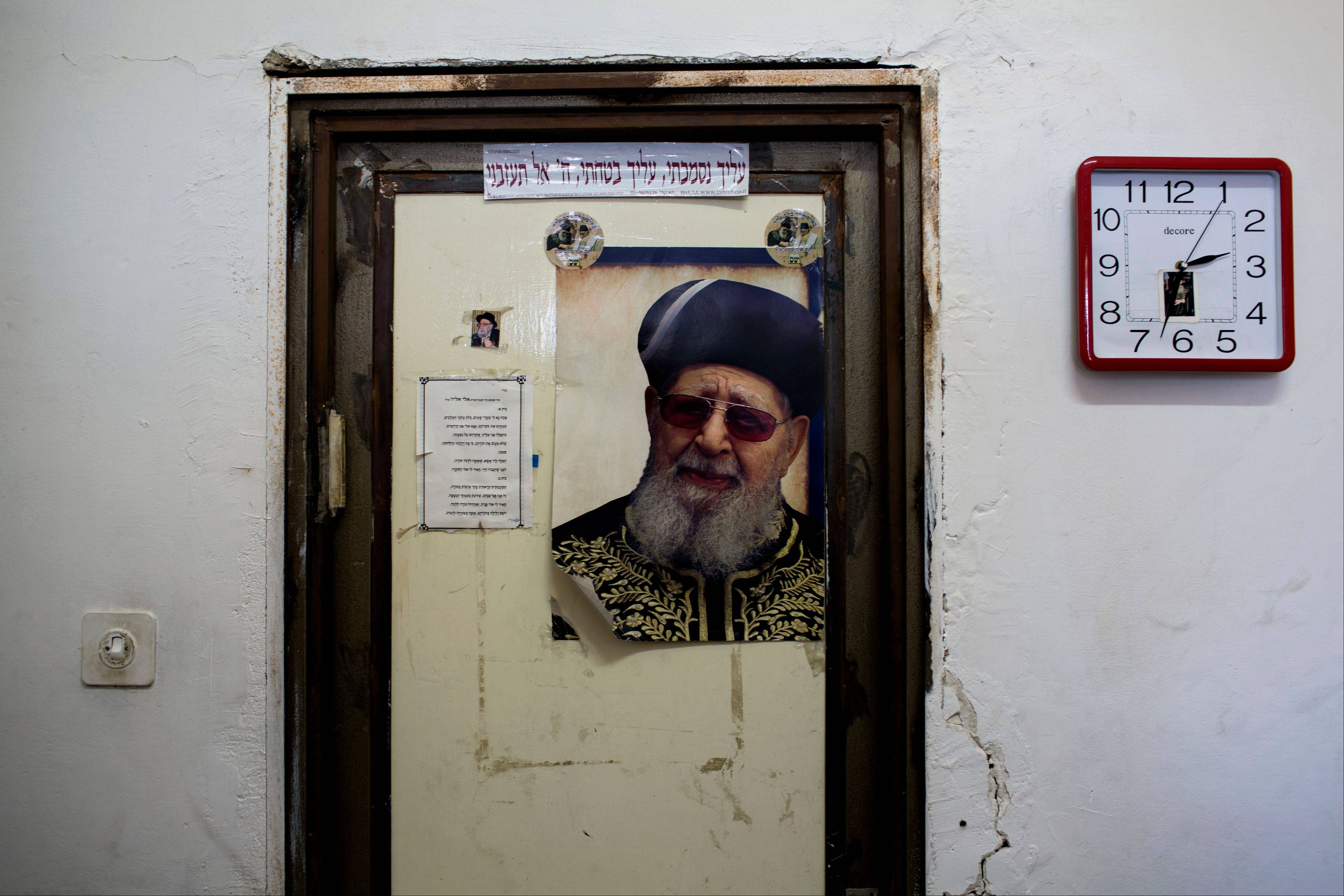 A portrait of Rabbi Ovadia Yosef hangs on a door in a yeshiva during his funeral in Jerusalem, Monday, Oct. 7, 2013. Rabbi Yosef, 93, a religious scholar and spiritual leader of Israel's Sephardic Jews, transformed his downtrodden community of immigrants from North Africa and Arab nations and their descendants into a powerful force in Israeli politics.