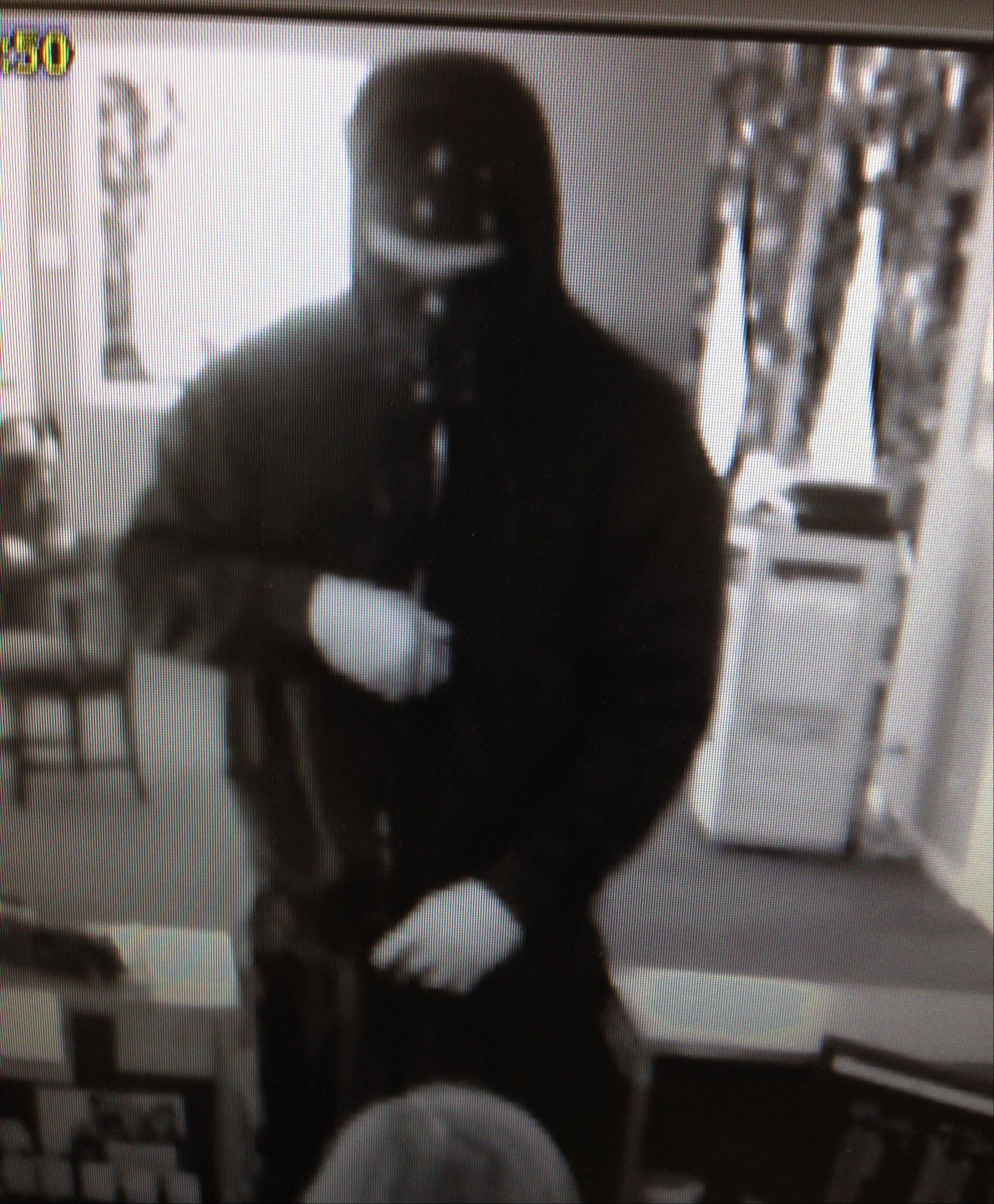 The masked suspect who robbed the American Midwest Bank near Gurnee Monday.