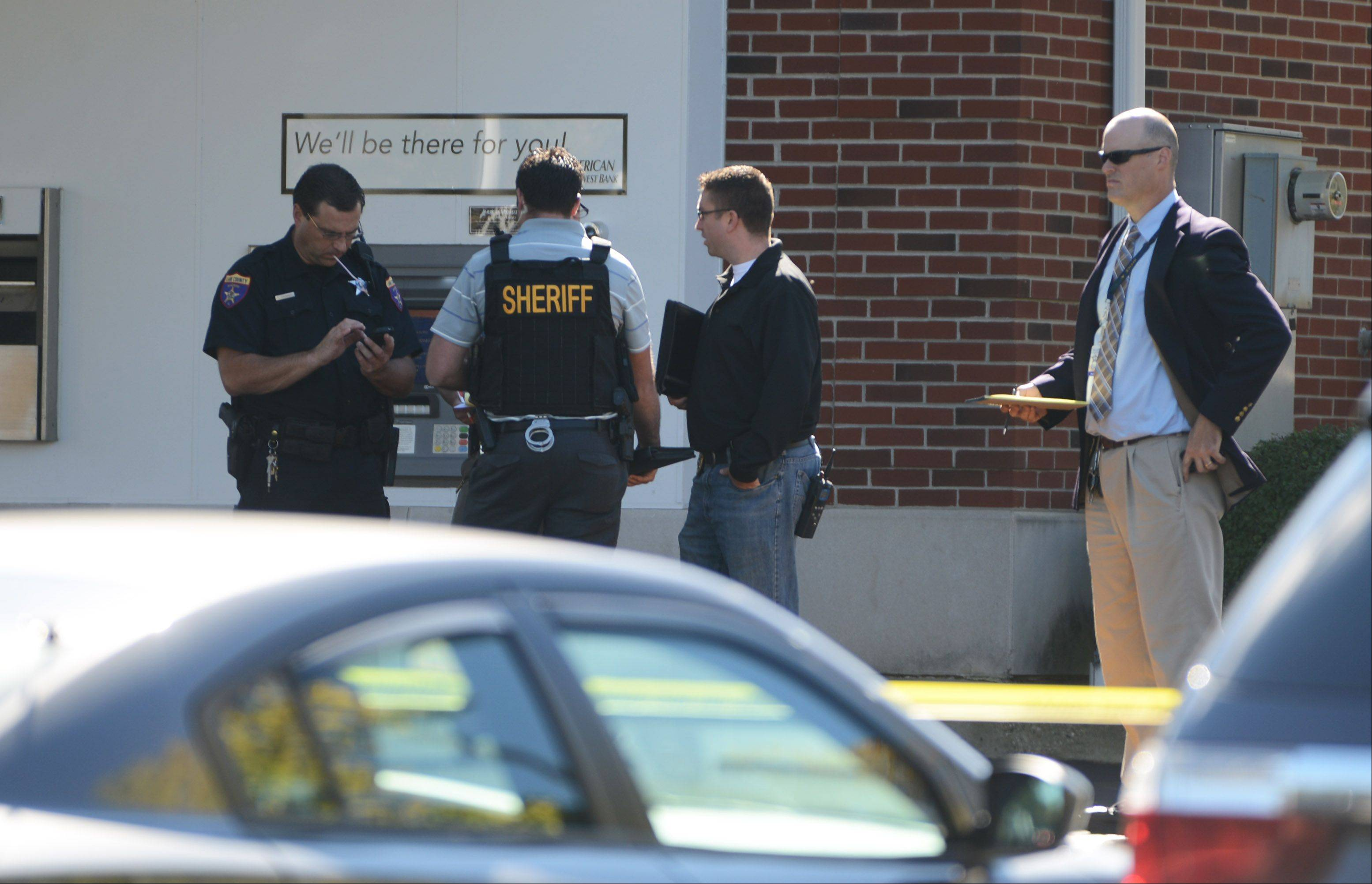 Lake County sheriff's officials investigate a robbery Monday at the American Midwest Bank near Gurnee.