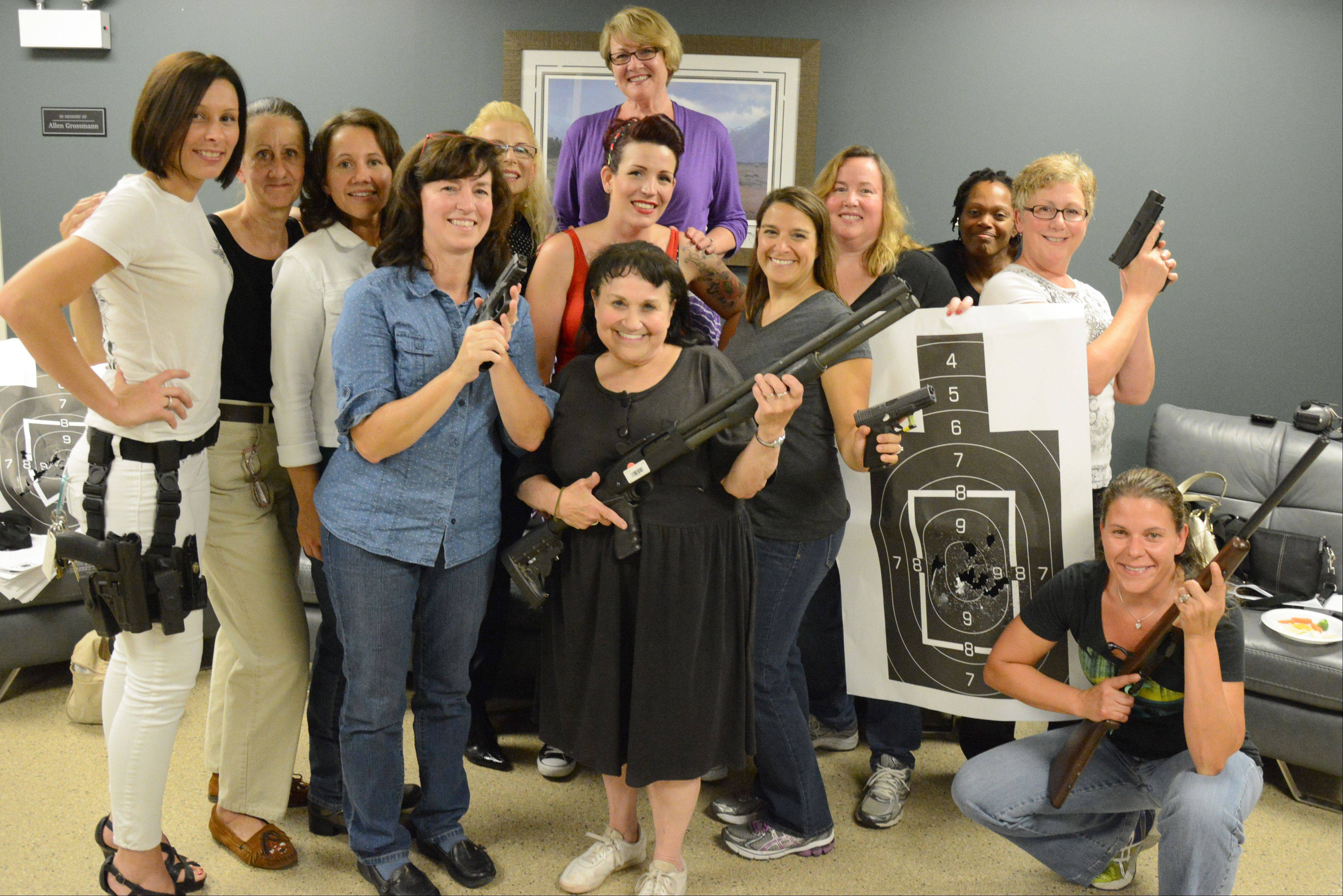 Participants pose for a photo during one of the monthly ladies' nights at Maxon, an indoor gun range and shooter's supply store in Des Plaines.