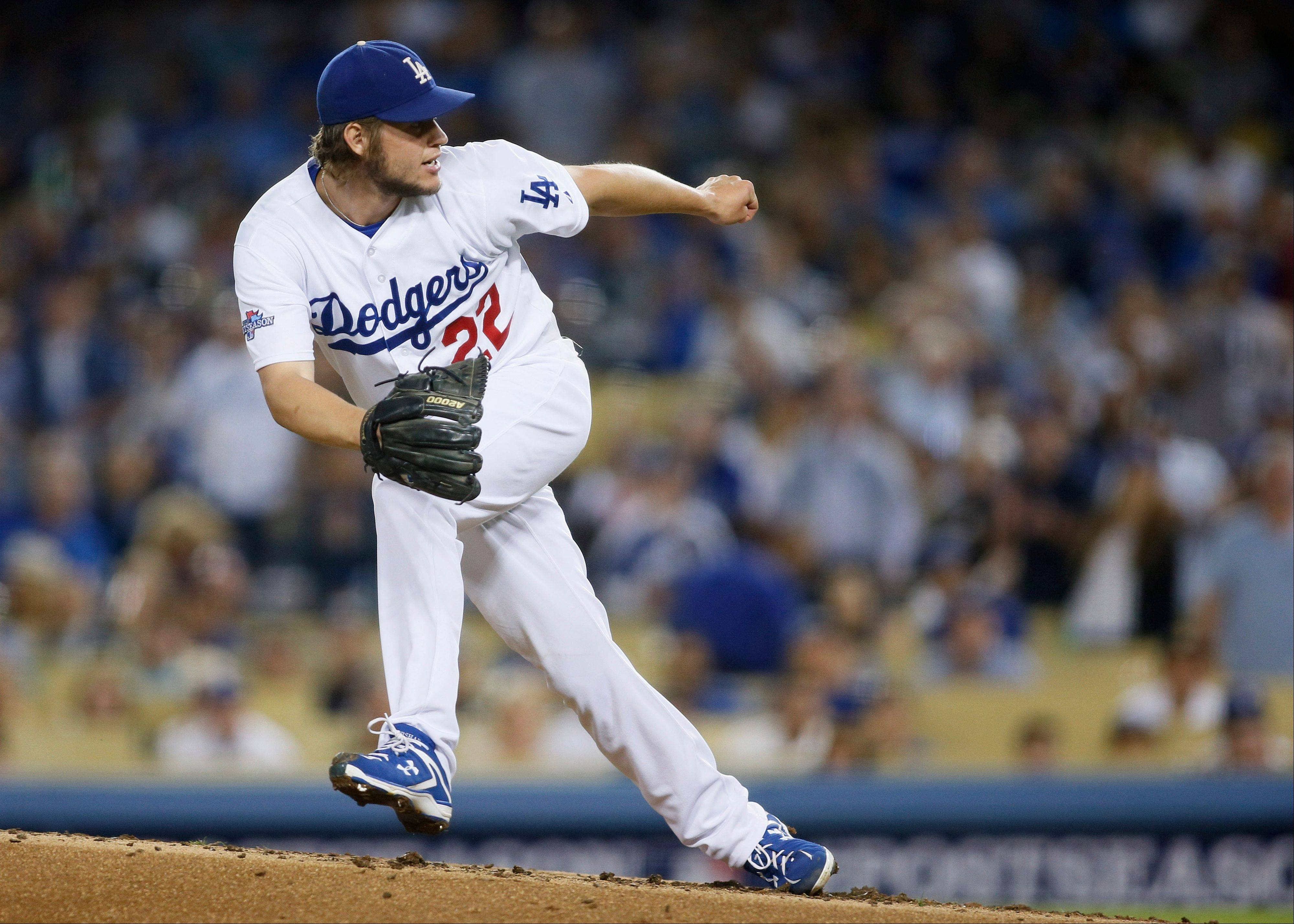 Dodgers starter Clayton Kershaw follows through on a pitch in the third inning of Game 4 Monday night.