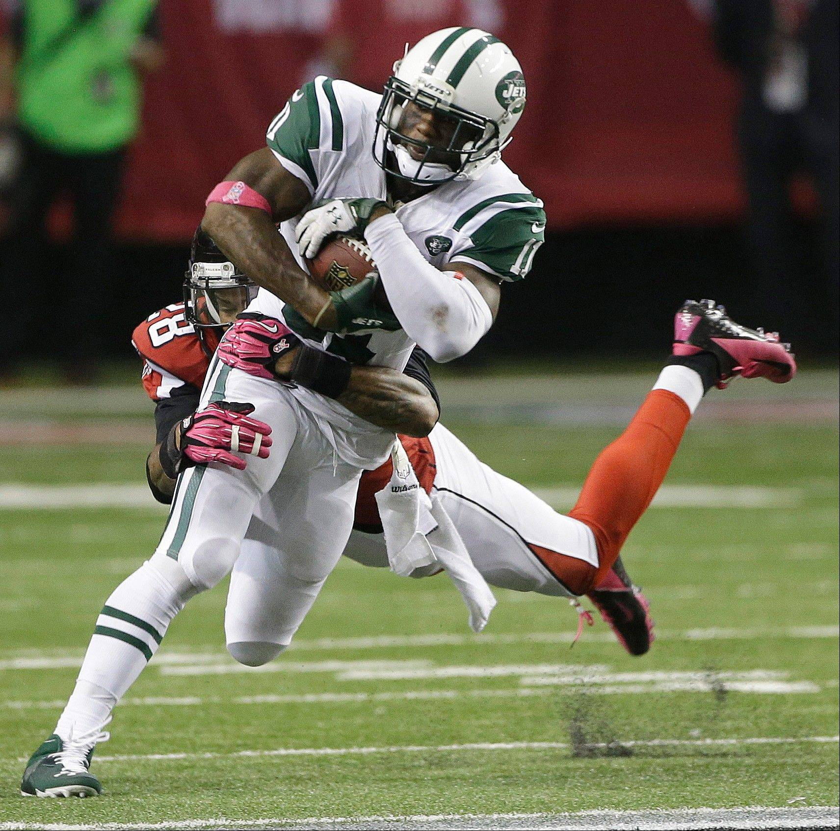 Falcons free safety Thomas DeCoud tackles Jets wide receiver Jeremy Kerley during the second half of Monday night's game in Atlanta.
