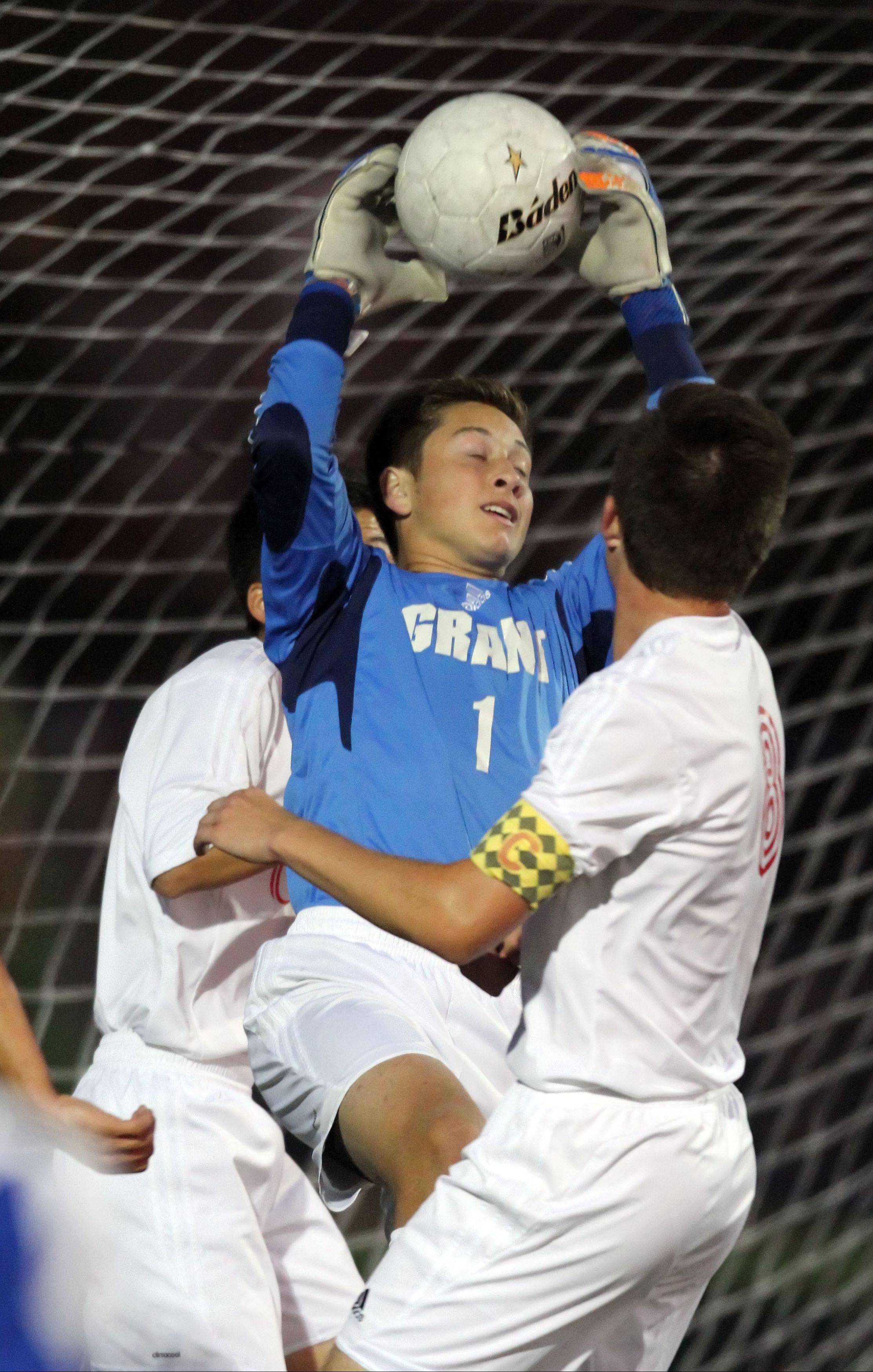 Grant goalie Nick Heidenthal makes a save against Lakes on Monday night at Grant.