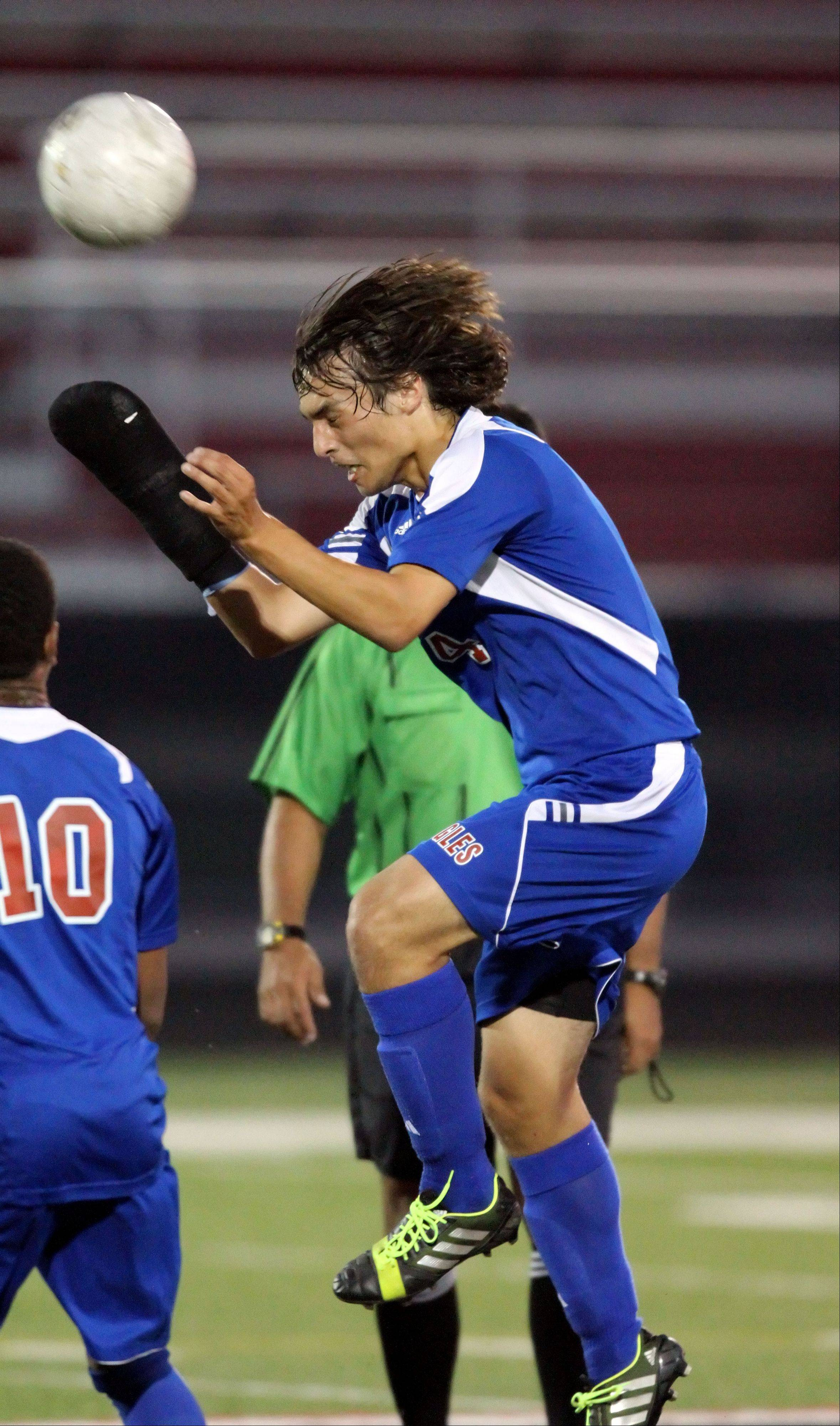 Lakes' Jon Borzick goes up for a header Monday night at Grant.