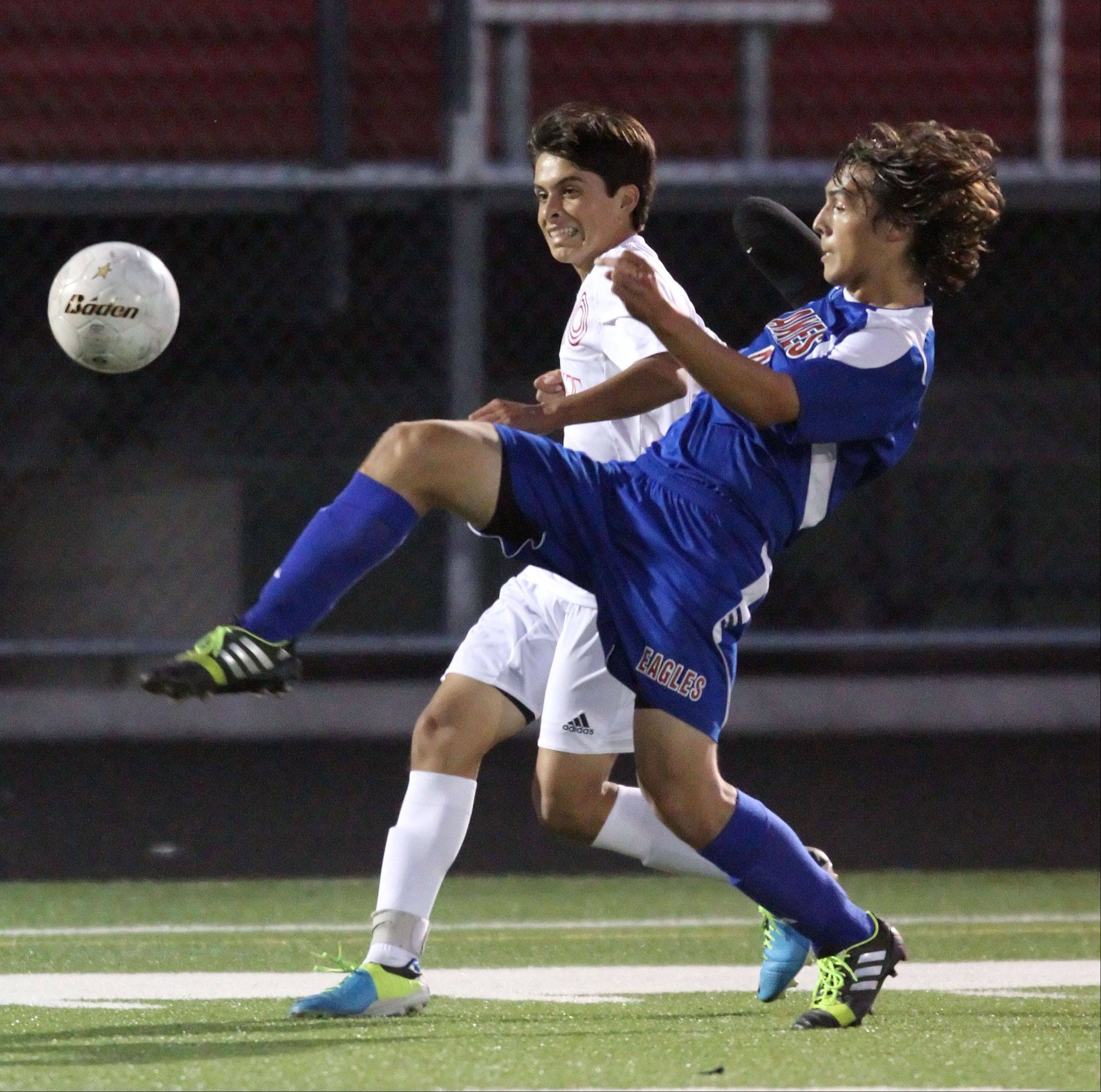 Lakes' Jon Borzick, right, and Grant's Kevin Peralta battle for the ball Monday night at Grant.