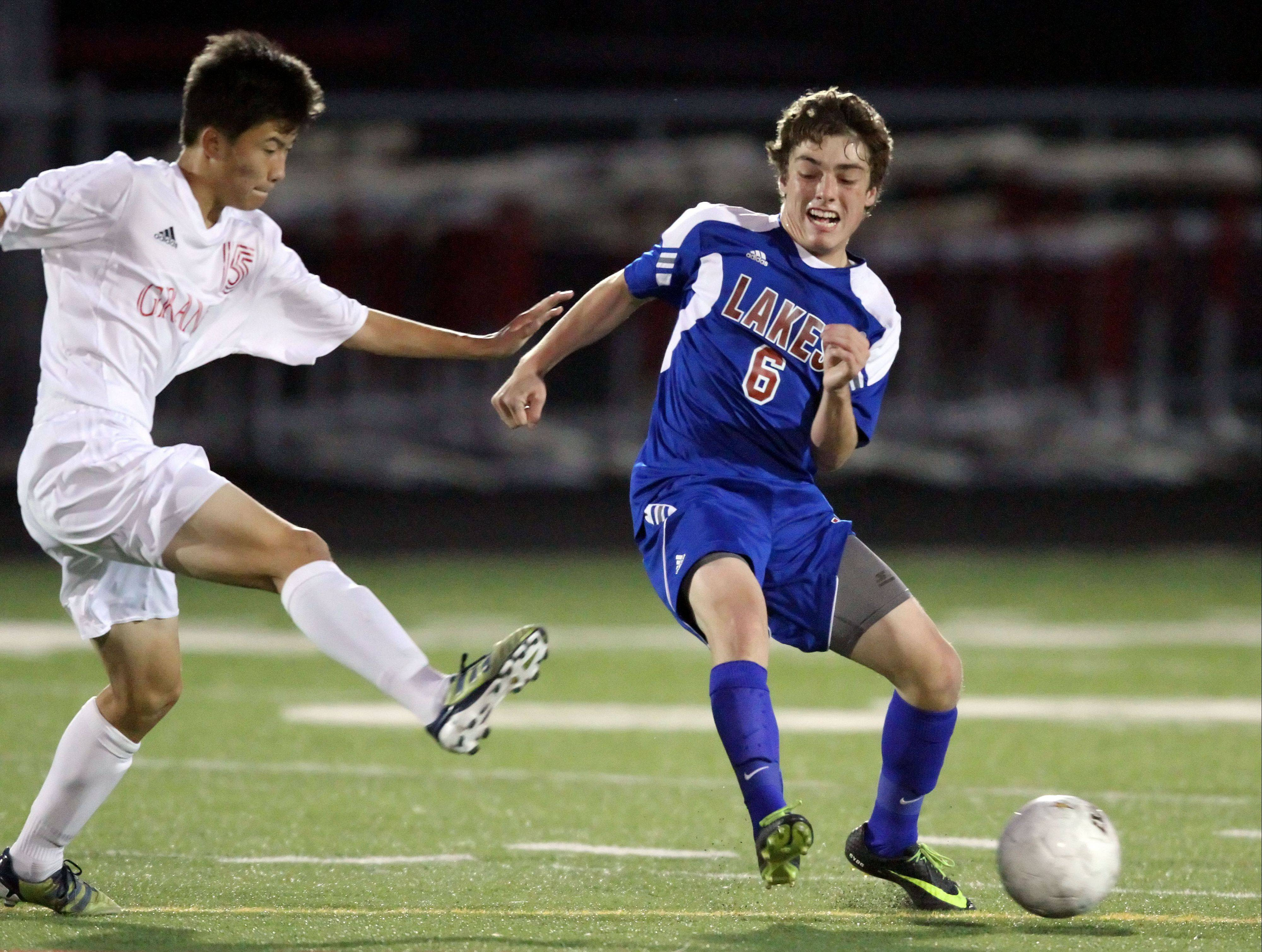 Grant's Daniel Lee and Lakes' Nick Dydo battle Monday night at Grant.