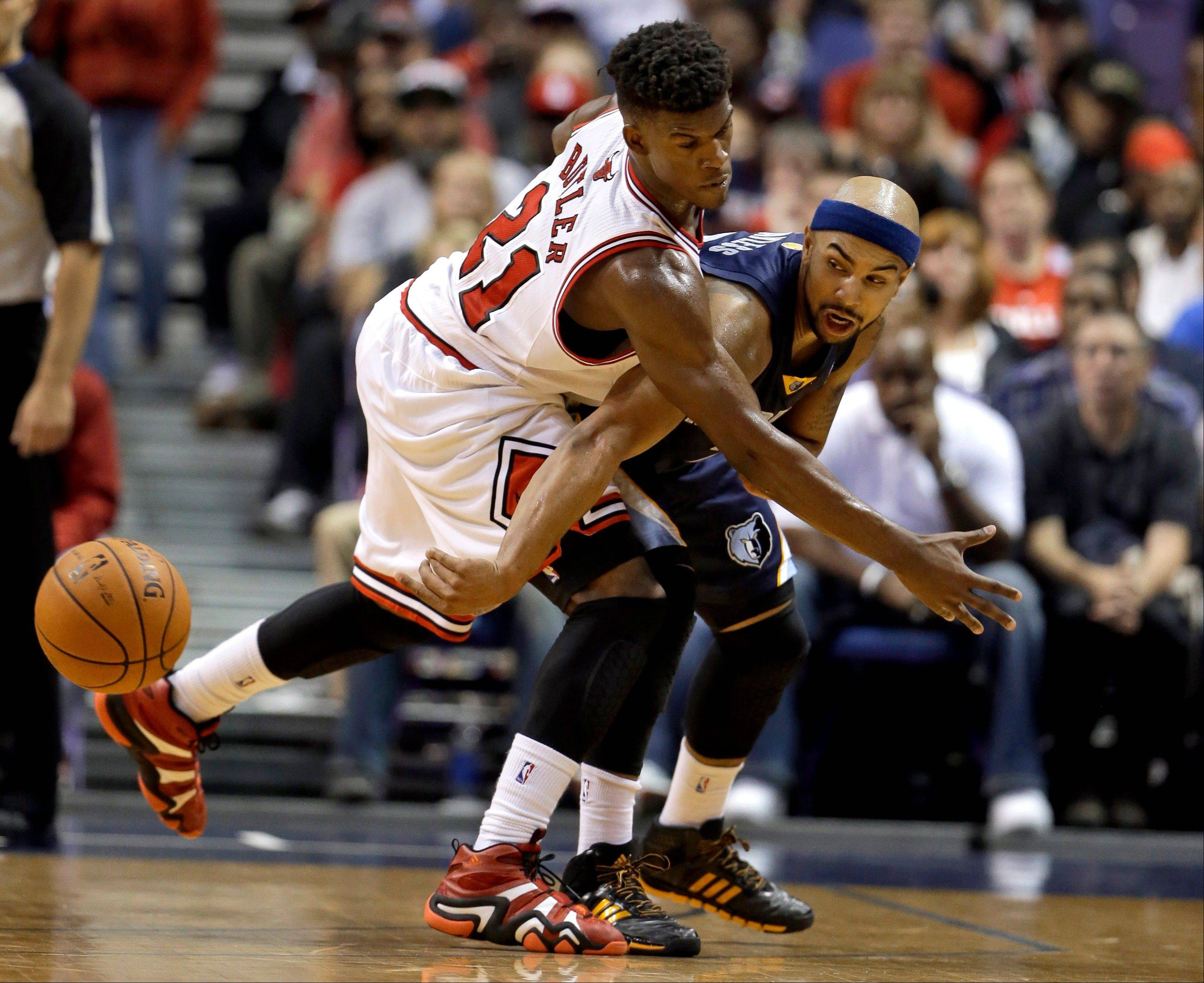 The Grizzlies' Jerryd Bayless, right, passes around the Bulls' Jimmy Butler during the second half of an NBA preseason basketball game Monday in St. Louis. The Bulls won 106-87.
