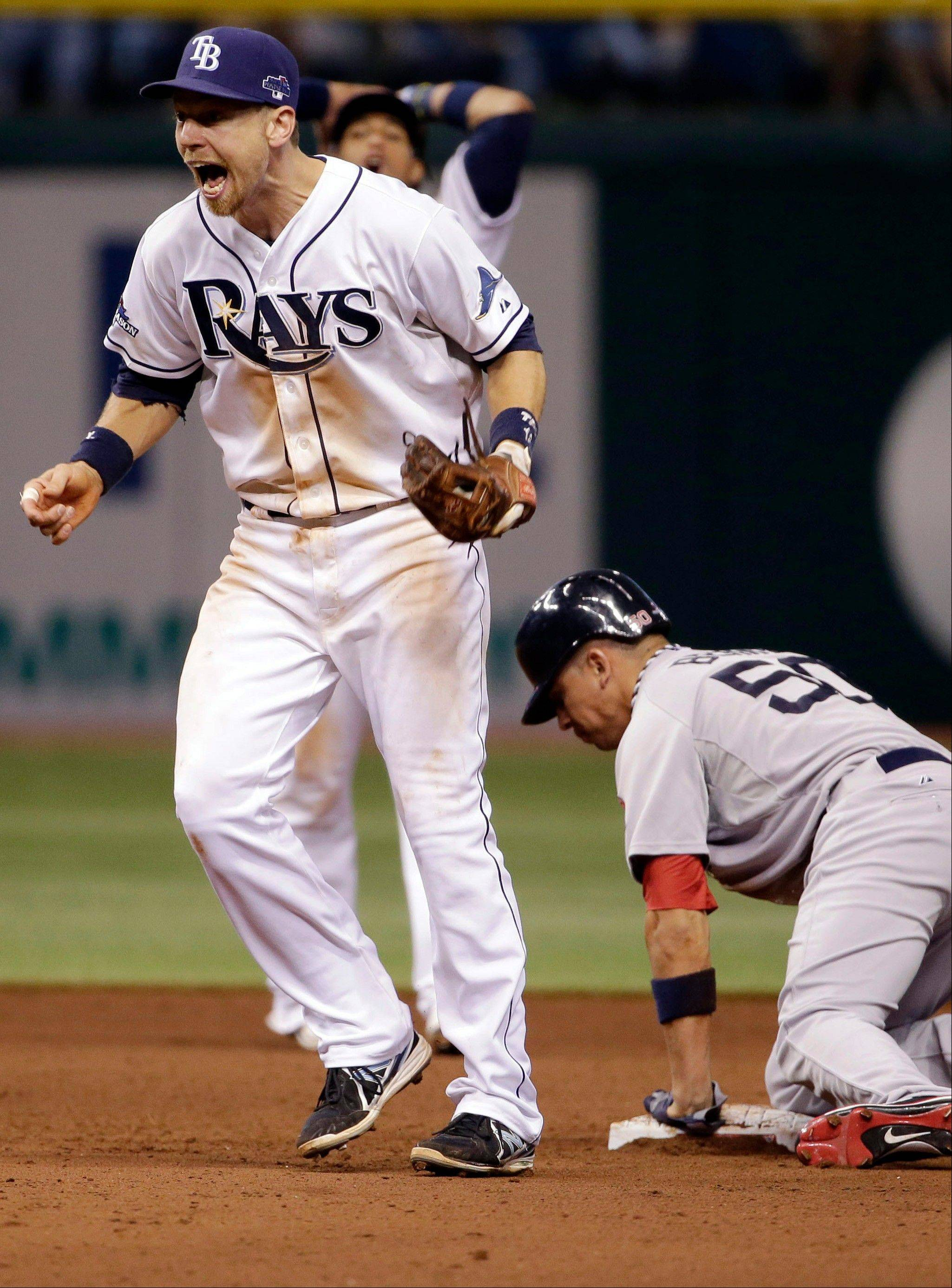 Tampa Bay Rays second baseman Ben Zobrist, left, reacts to a safe call after Boston's Quintin Berry stole second base on a close play in the eighth inning Monday.