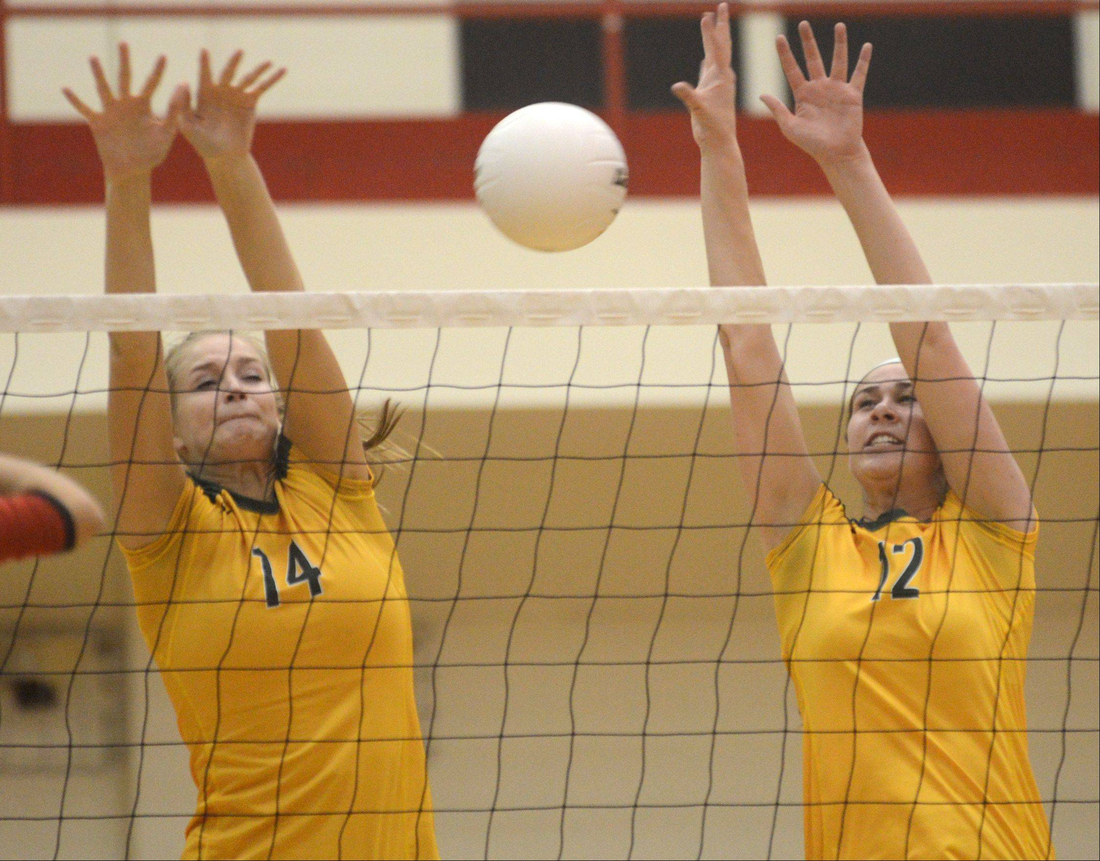 Stevenson's Kara Maleski, left, and Julia Osmond set up the block against host Palatine on Monday night.
