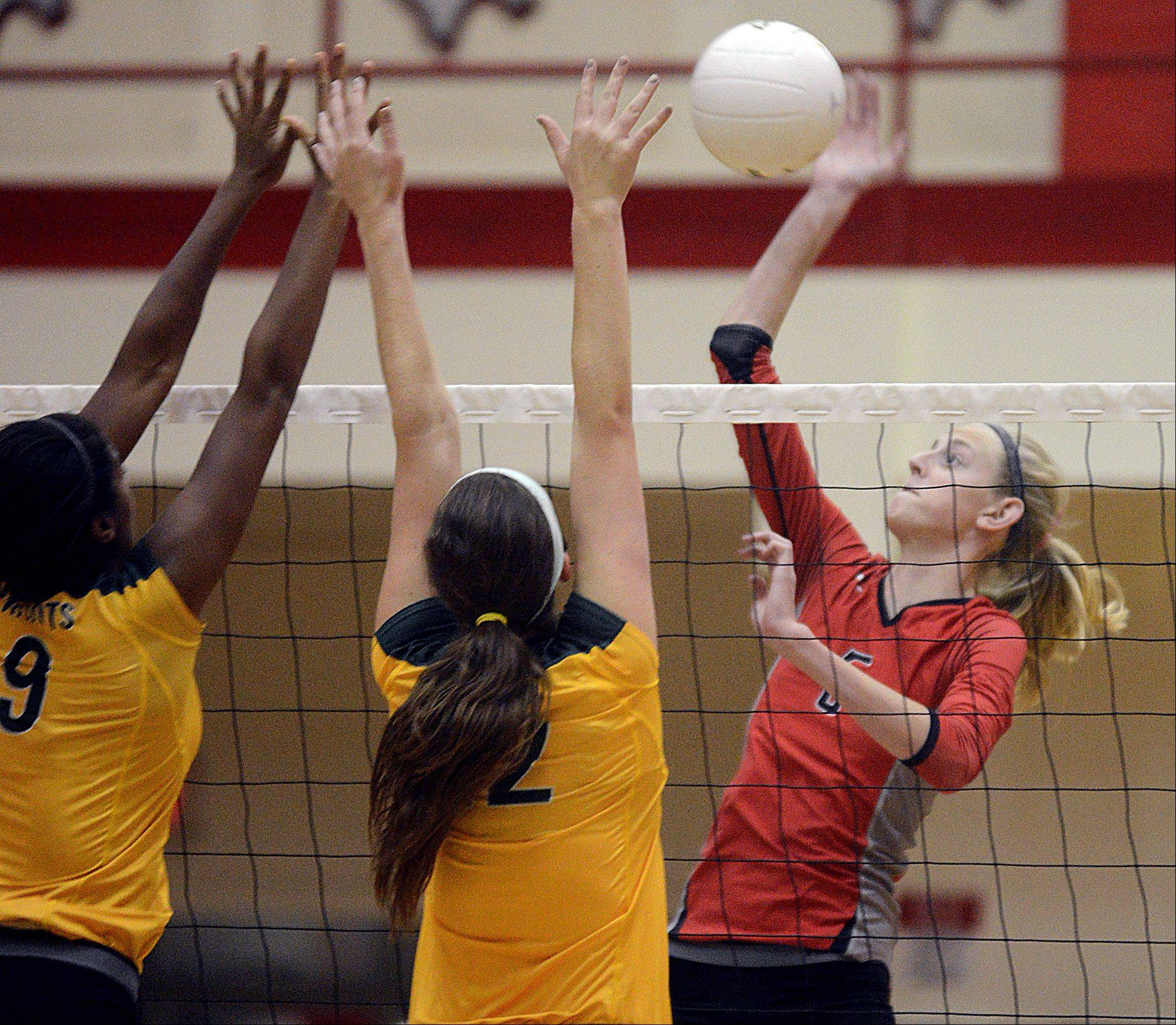 Palatine's Kimberly Butler, right, goes on the attack against Stevenson in nonconference play at Palatine on Monday night.