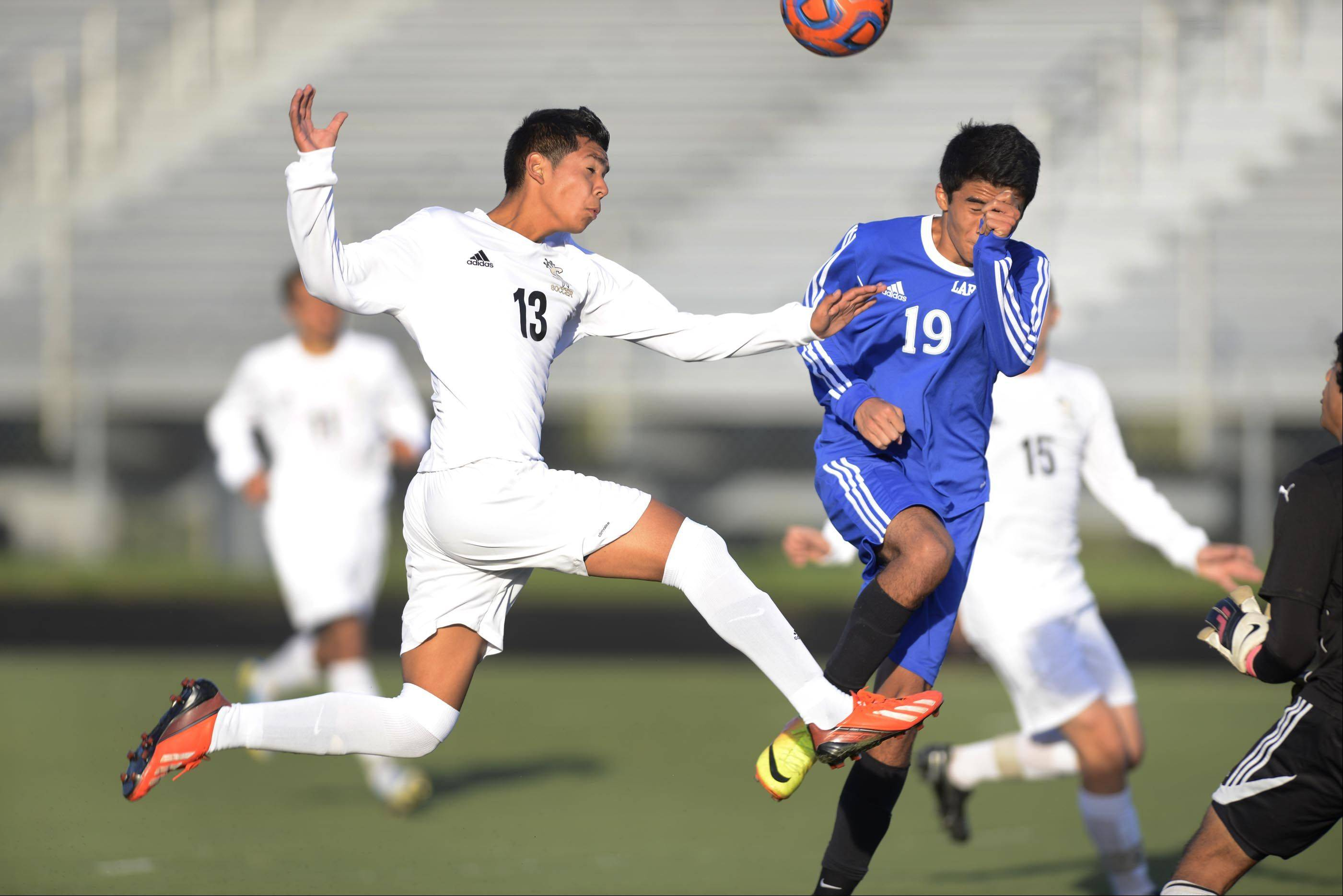 Streamwood's Donnie Sosa and Larkin's Diego Ramirez, right, compete for a corner kick Monday in Streamwood.