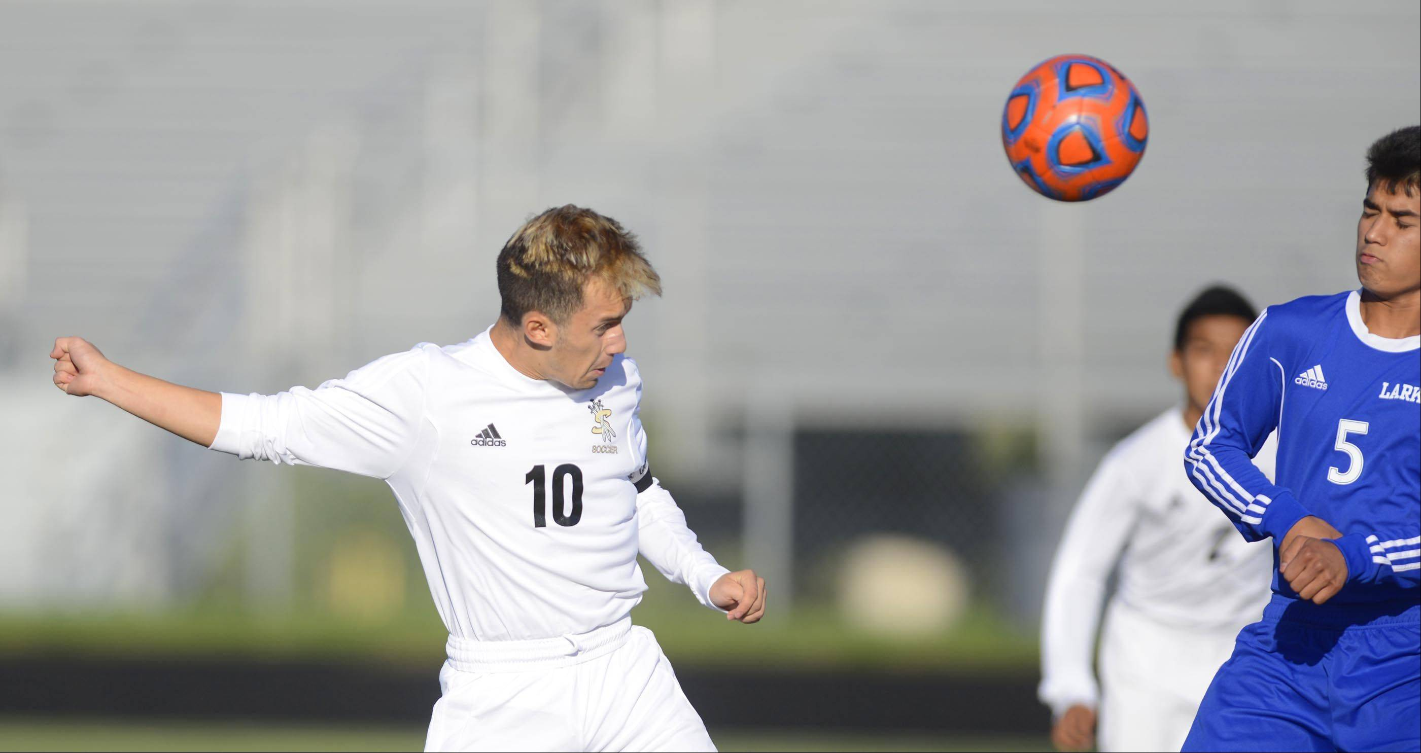 Streamwood's Nestor Ascencio redirects a corner kick but misses the net against Larkin Monday in Streamwood.