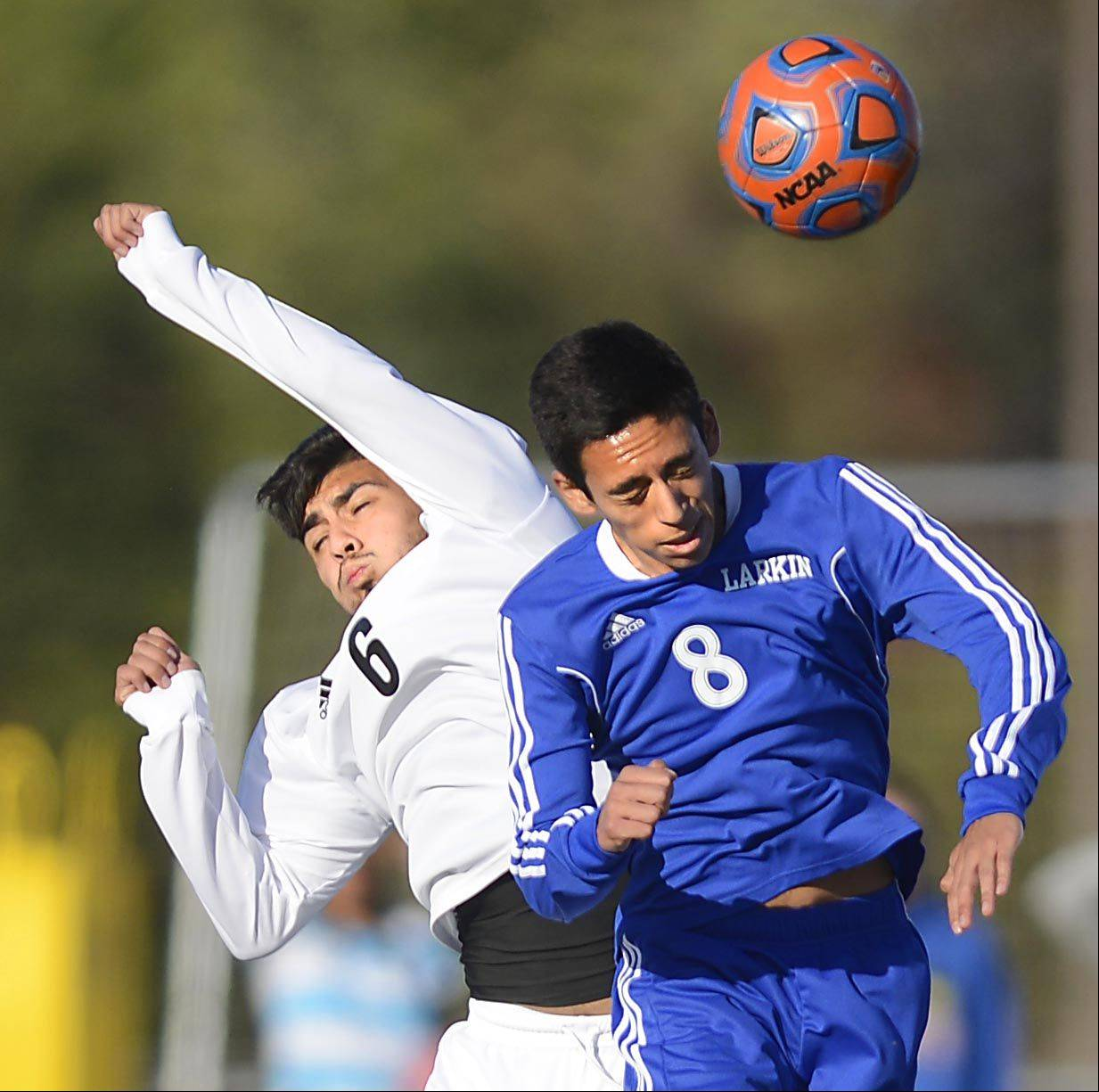 Streamwood's Christian Vences and Larkin's Jesus Avila, right, compete for a midfield header Monday in Streamwood.