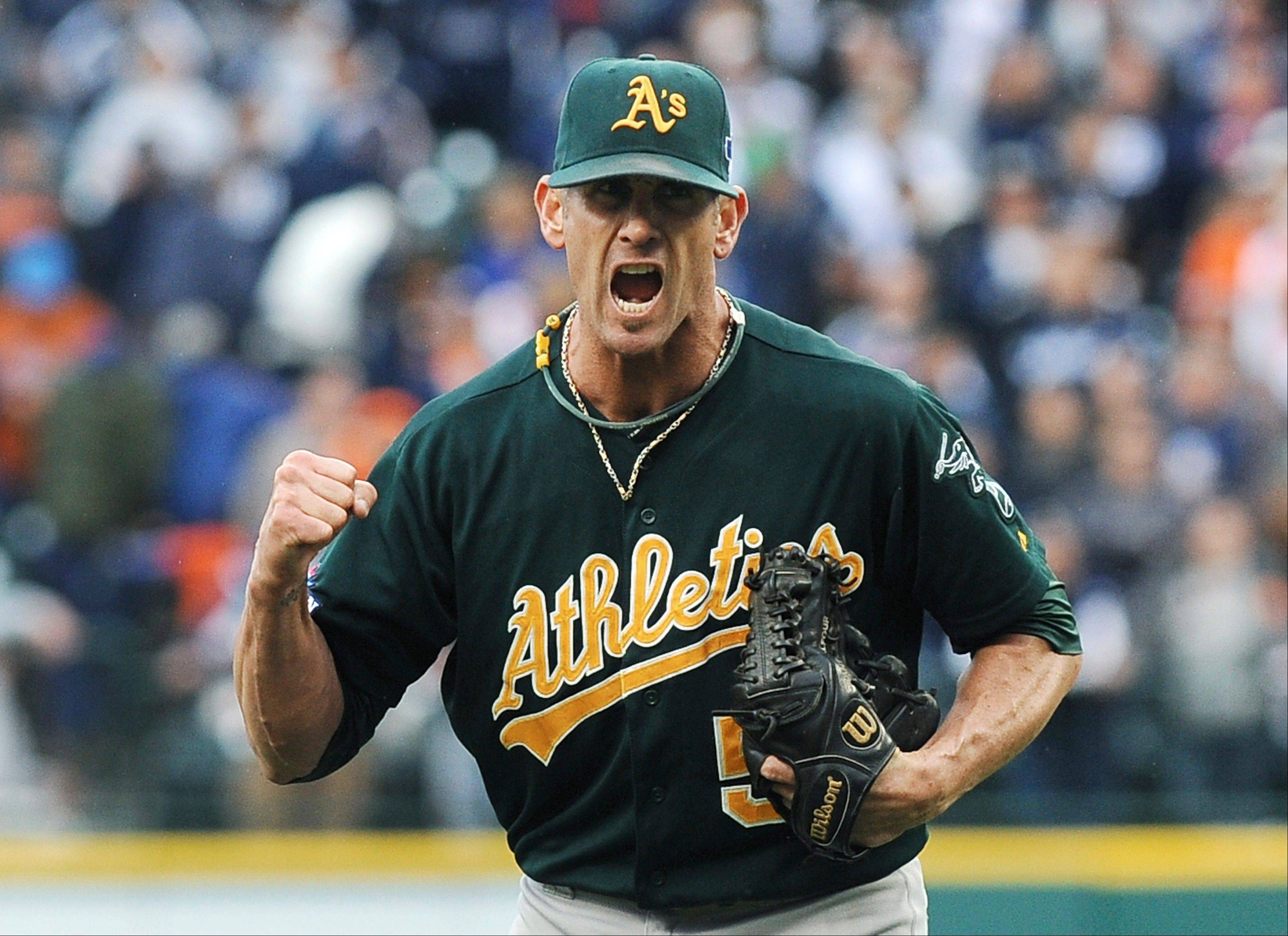 Athletics relief pitcher Grant Balfour clenches his fist after the final out in Game 3 of an American League Division Series against the Tigers in Detroit.