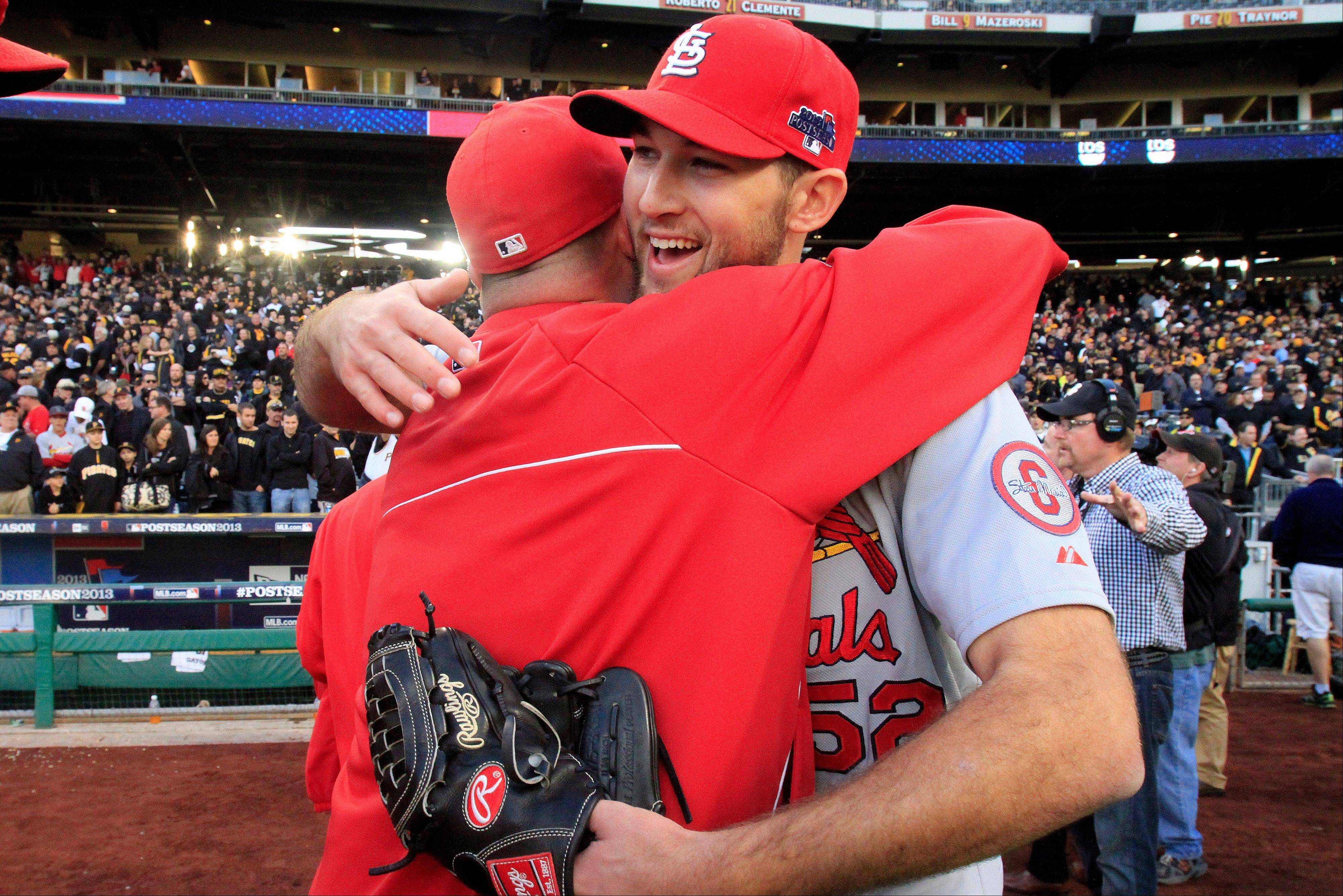 St. Louis Cardinals pitcher Michael Wacha, right, celebrates with teammates after a 2-1 win over the Pittsburgh Pirates in Game 4 of a National League Division Series on Monday in Pittsburgh.