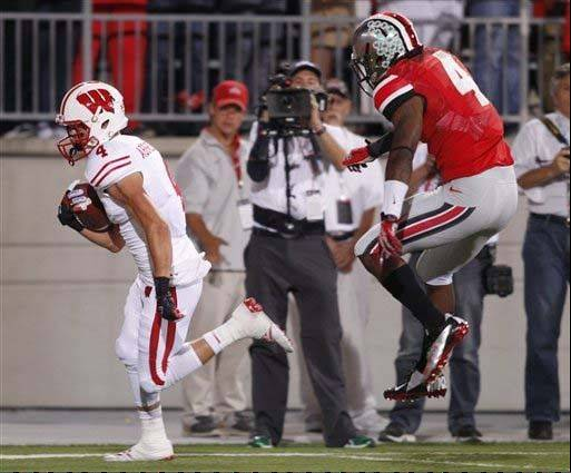 Wisconsin wide receiver Jared Abbrederis scores a touchdown past Ohio State defensive back C.J. Barnett during the first quarter of the Badgers' 31-24 loss on Sept. 28 in Columbus, Ohio.