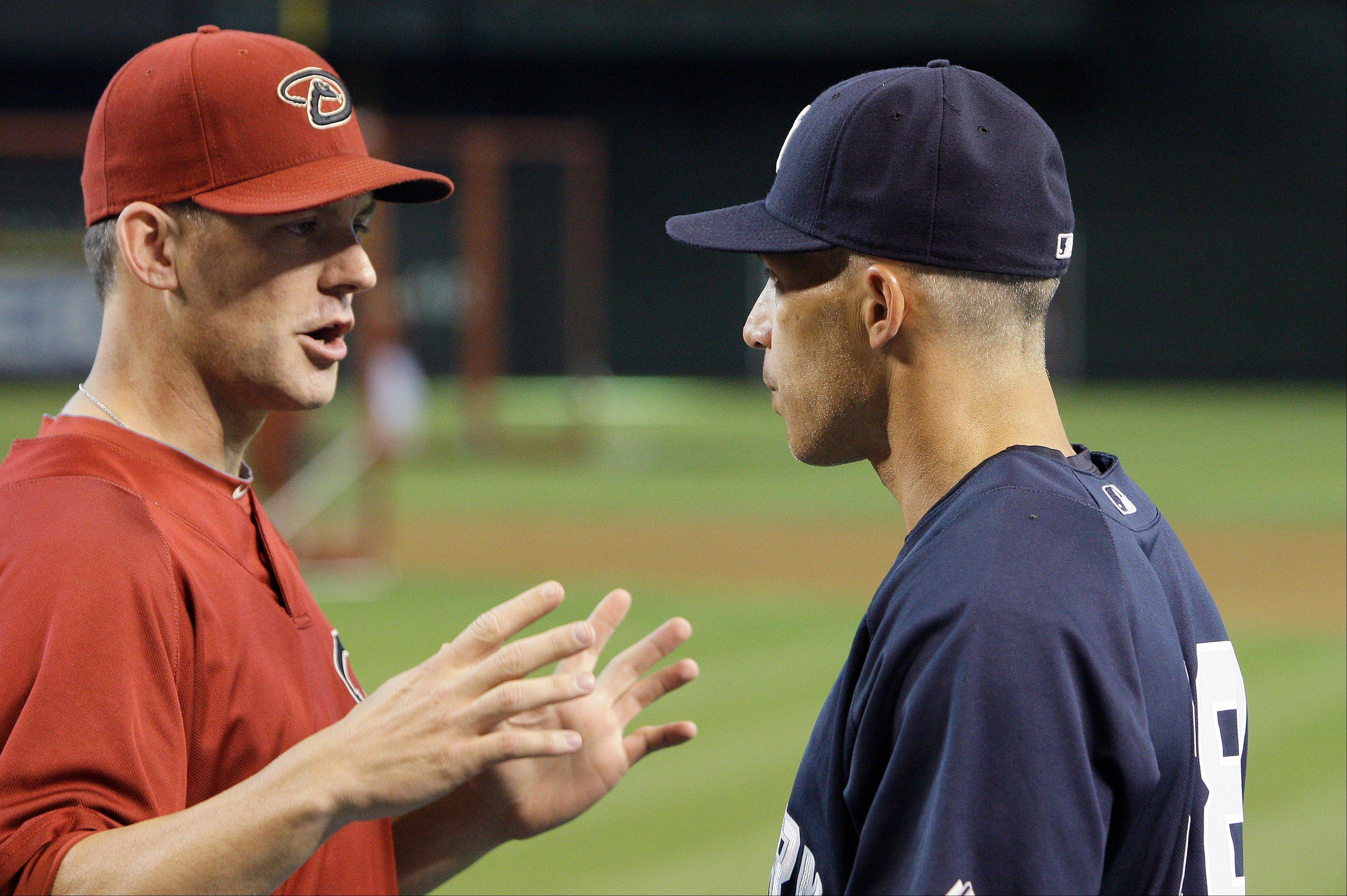 Two possible contenders for the Cubs managerial job, former Arizona Diamondbacks manager A.J. Hinch, left, and New York Yankees manager Joe Girardi, had a pregame talk in Phoenix before a 2010 game between their clubs.